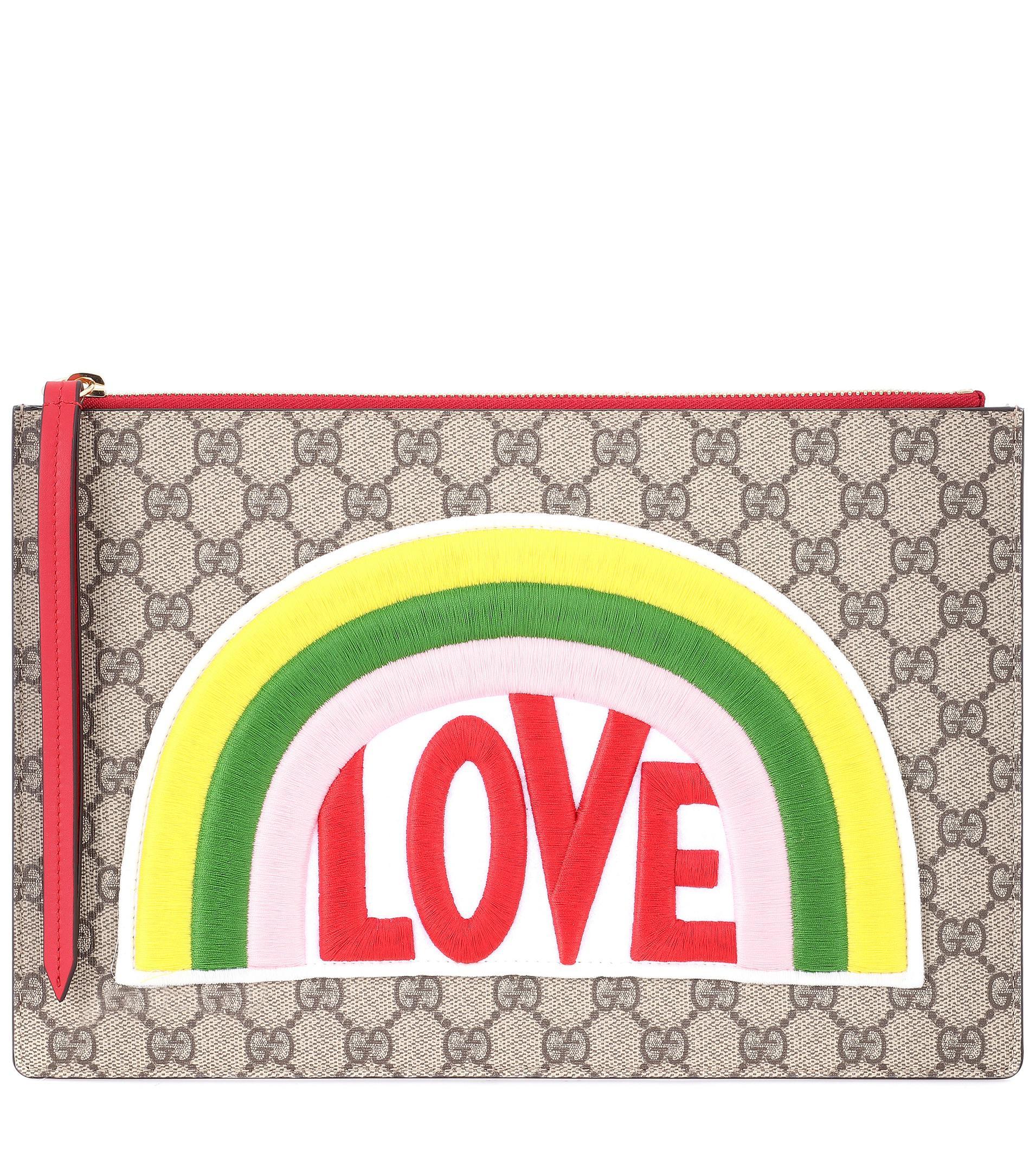 Lyst - Pochette en cuir et toile GG Suprême à appliqué Gucci a311e5eb393f
