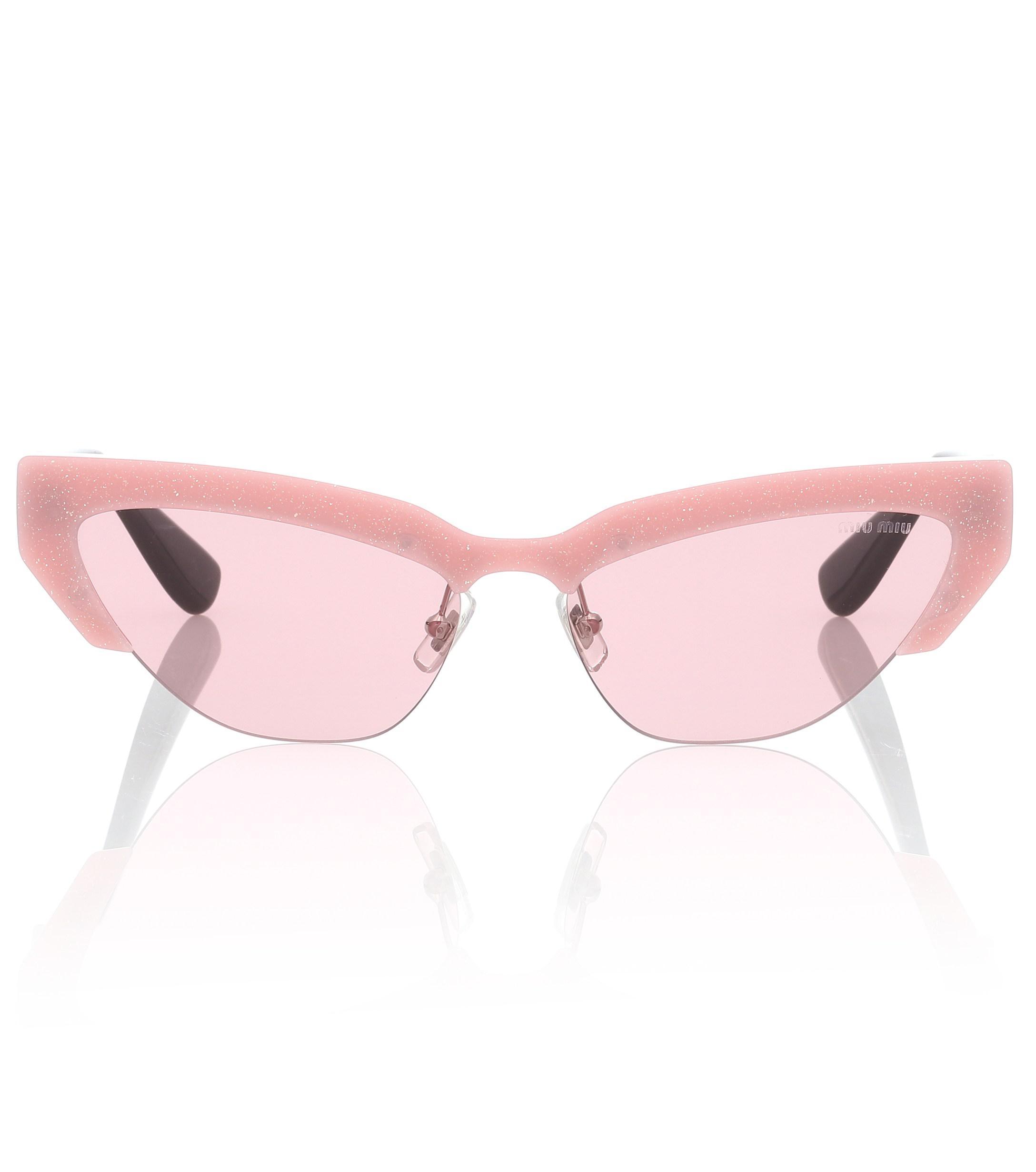 847c8bf7d17 Lyst - Miu Miu Cat-eye Sunglasses in Pink