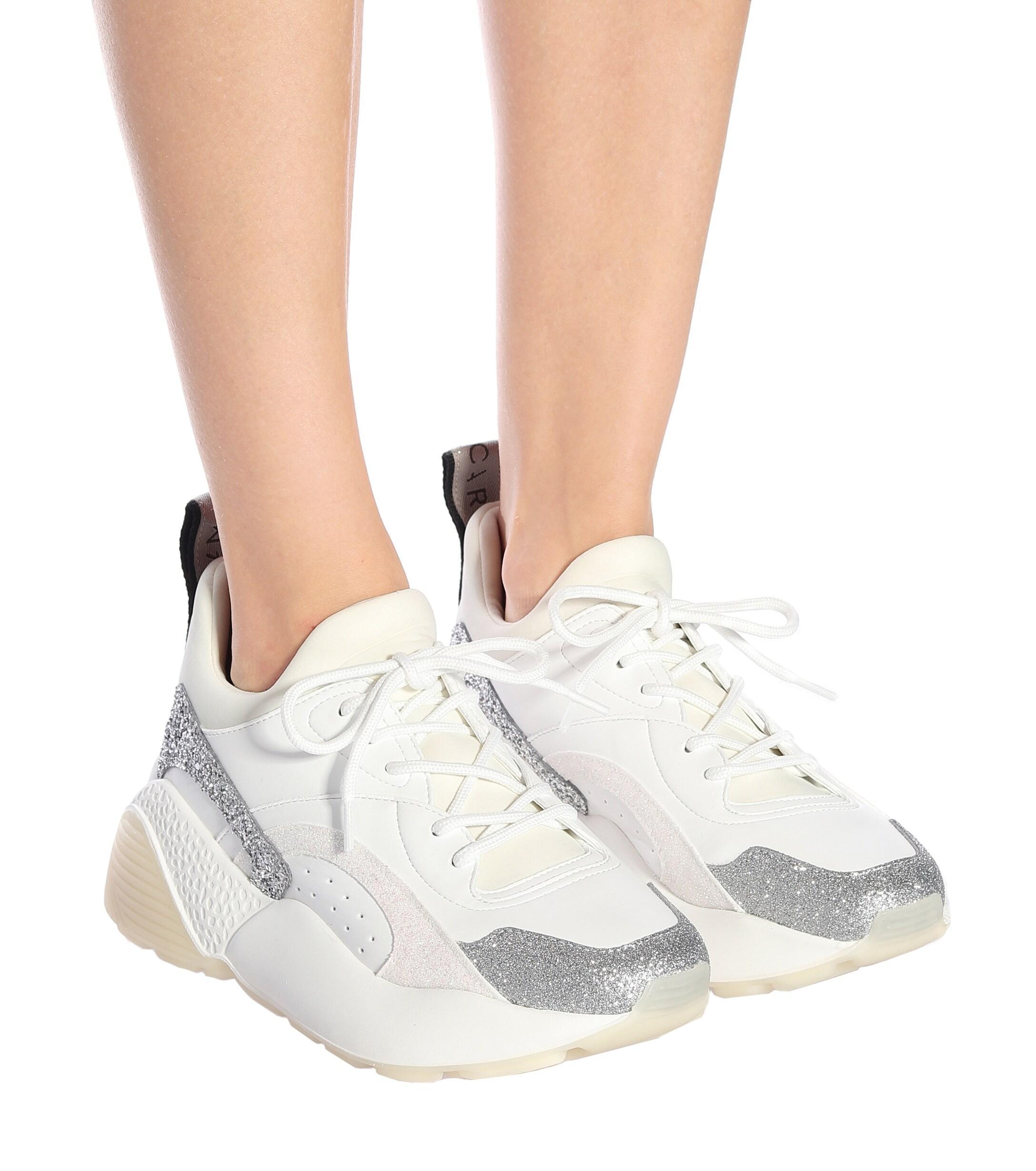 Zapatillas Elyse con purpurina Stella McCartney de Tejido sintético de color Blanco: ahorra un 60 %