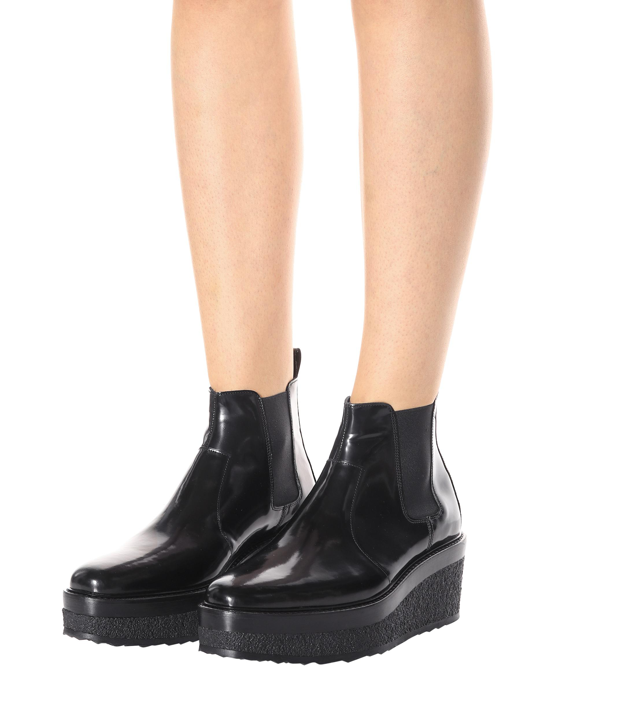 See more Pierre Hardy Wedges Ankle BOOTS in Black Shiny