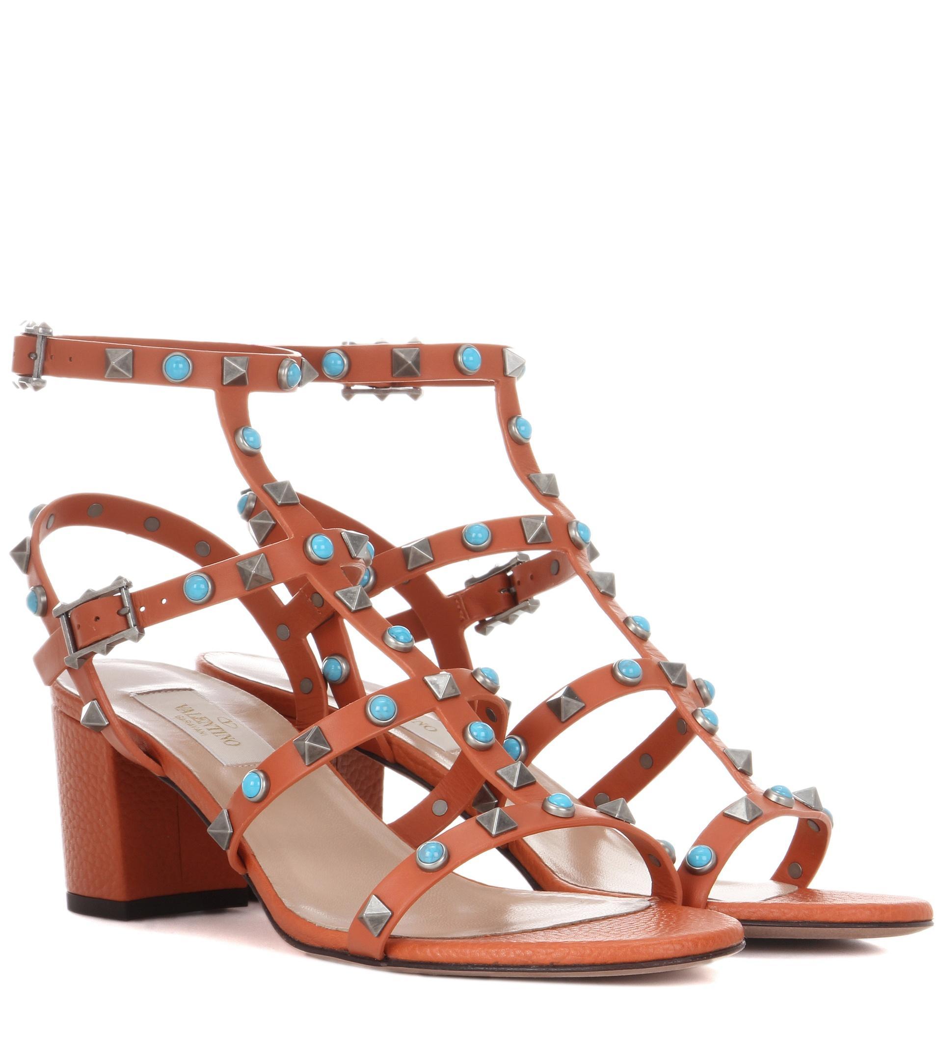 Lyst Valentino Garavani Rockstud Sandals In Orange