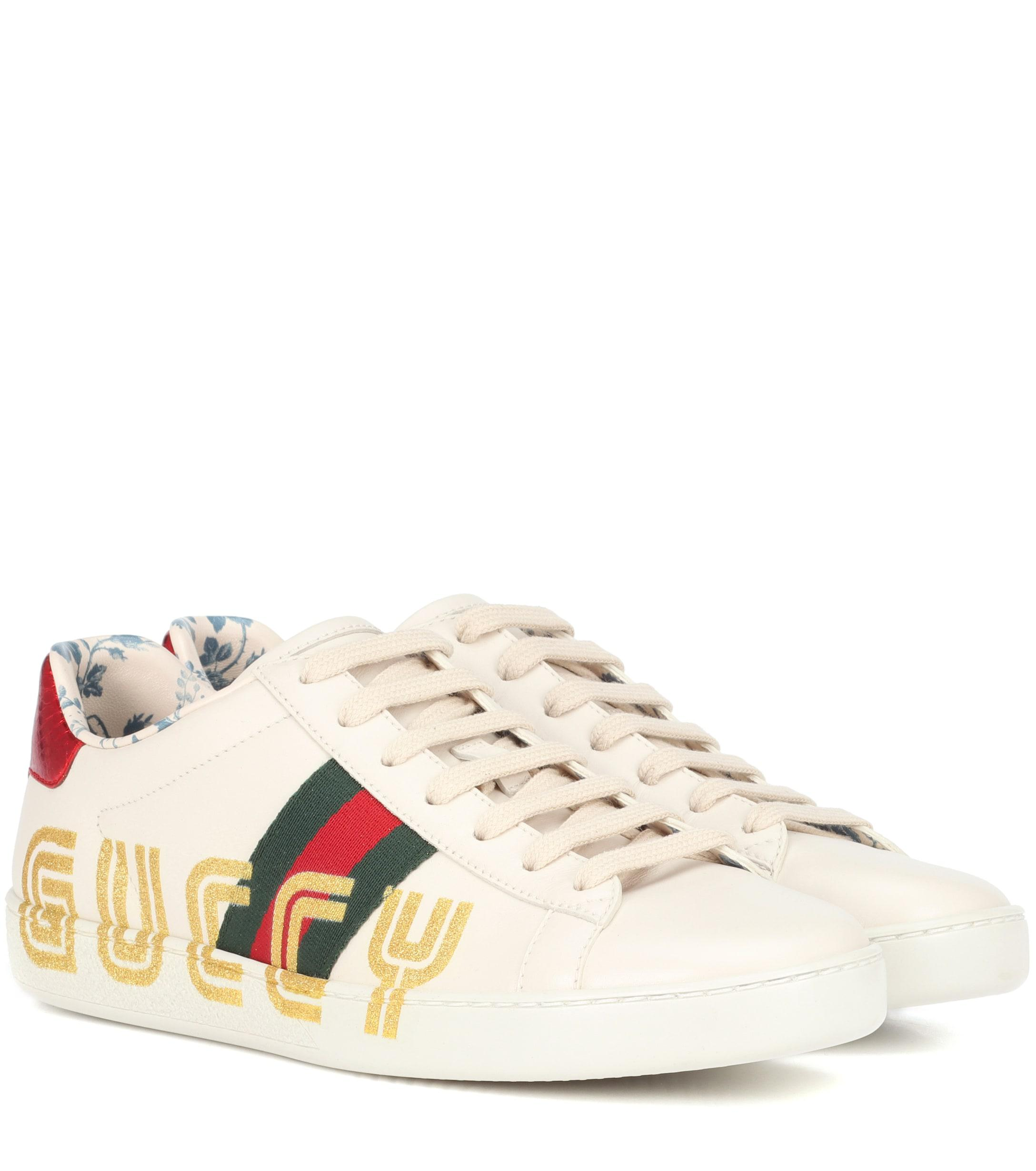 purchase cheap a7b1f c7a45 Lyst - Gucci Ace Leather Sneakers in White