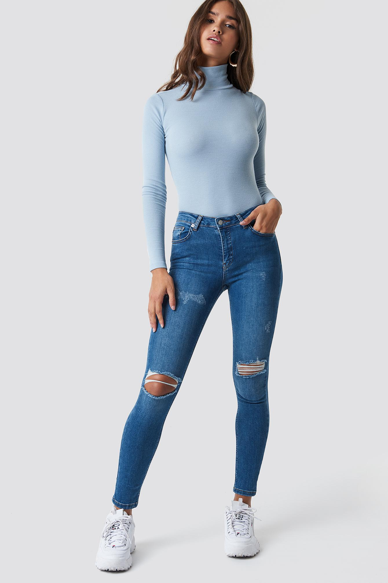 d2fbea0fe189 Lyst - NA-KD Skinny Mid Waist Destroyed Jeans Mid Blue in Blue