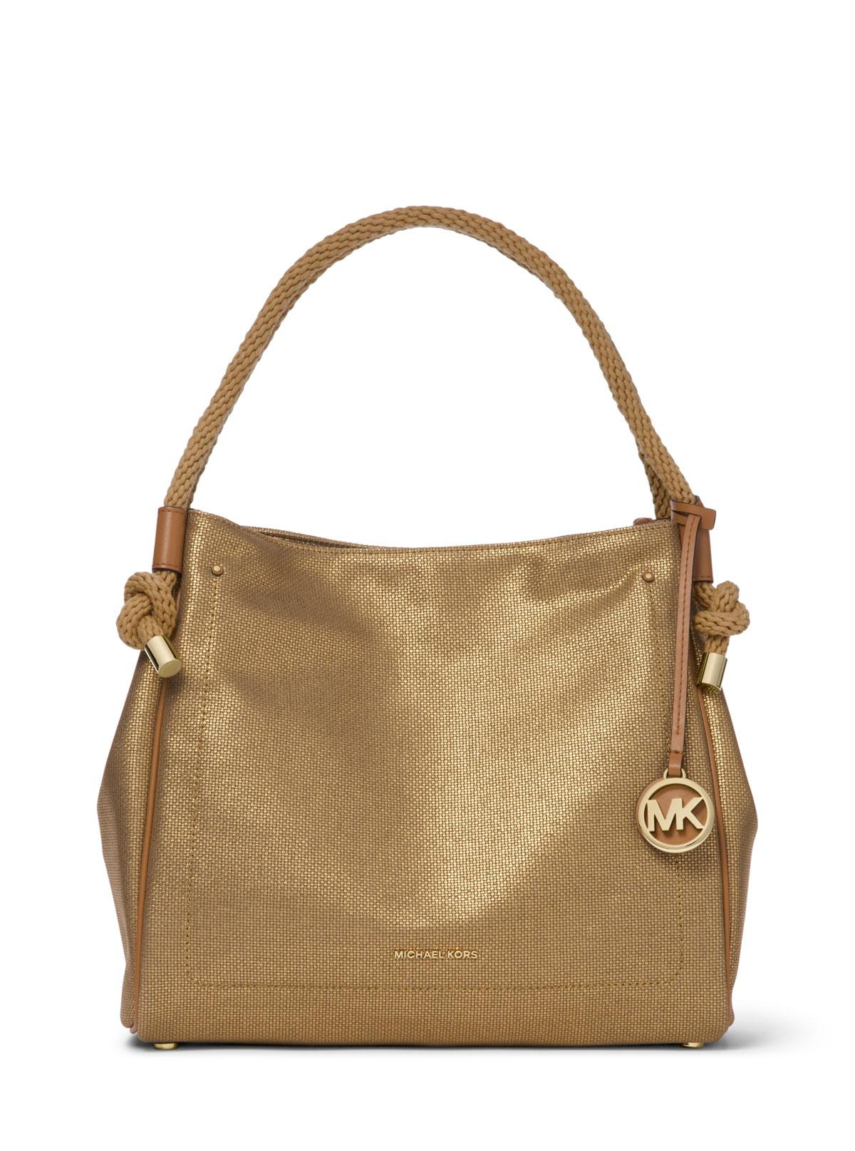 b589a8d1b1 Lyst - MICHAEL Michael Kors Isla Canvas Bucket Bag in Metallic ...