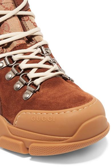 b79e83fe870 Gucci Brown Flashtrek Faux Shearling-trimmed Suede, Leather And Printed  Coated-canvas Boots