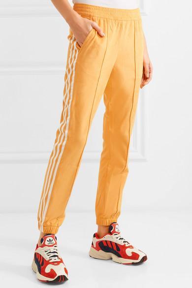 adidas beige jogginghose schwarze streifen
