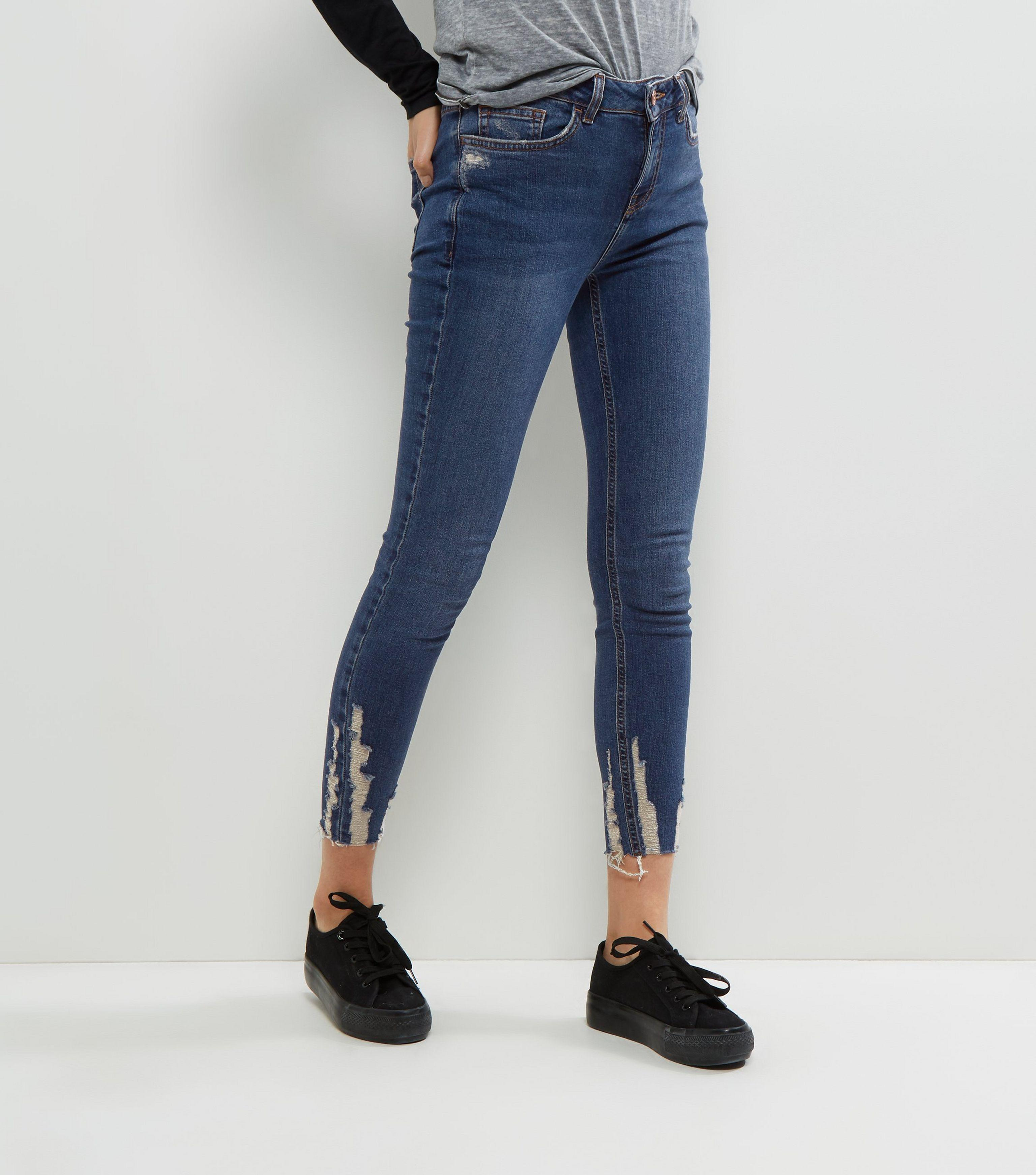 great deals 100% authenticated choose clearance New Look Denim Blue Ripped Hem Skinny Jenna Jeans - Lyst