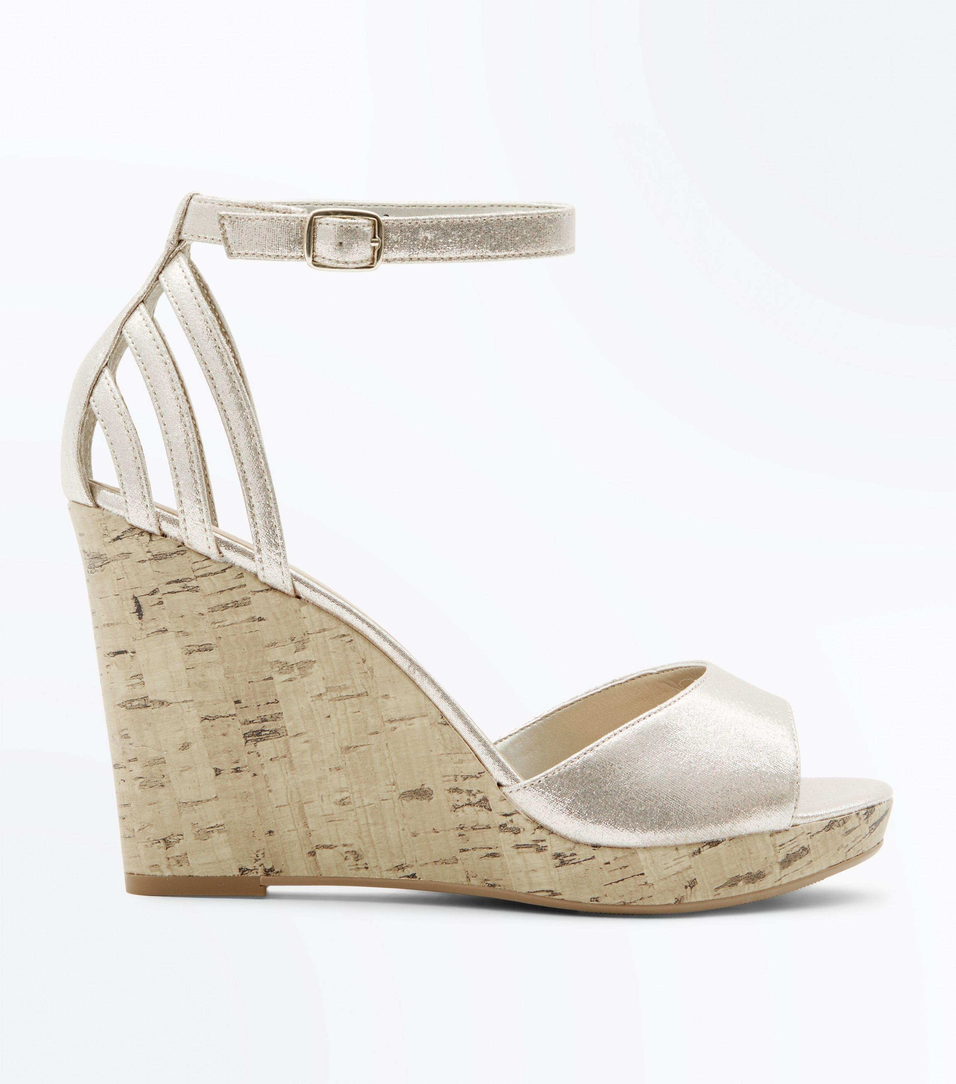 a8c0153e1c5 New Look Wide Fit Gold Cage Back Cork Wedges in Metallic - Lyst