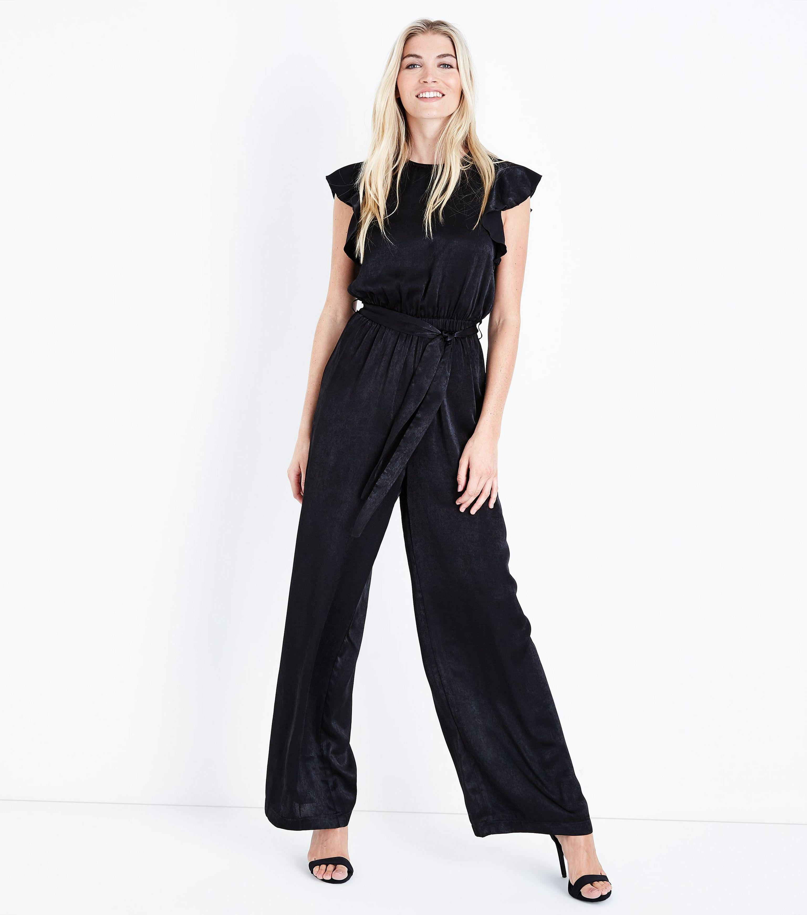a80fd893369 Mela Black Frill Sleeve Jumpsuit in Black - Lyst