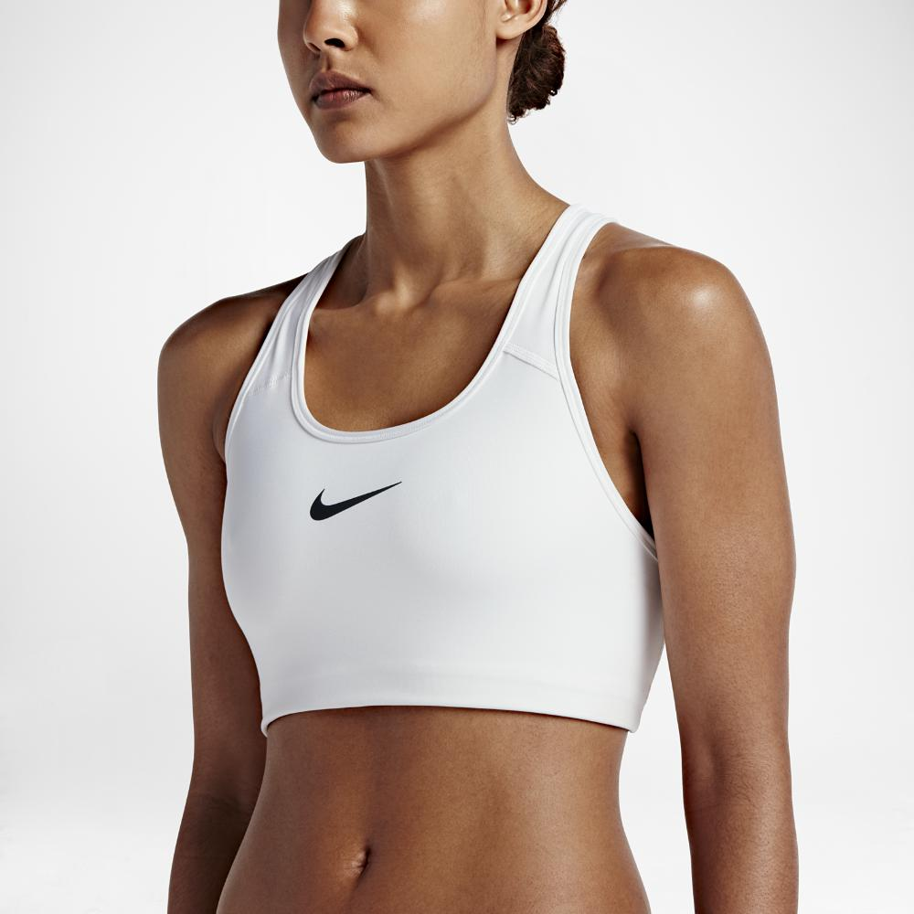 42f176a3a4 Lyst - Nike Pro Classic Swoosh Women s Medium Support Sports Bra in ...