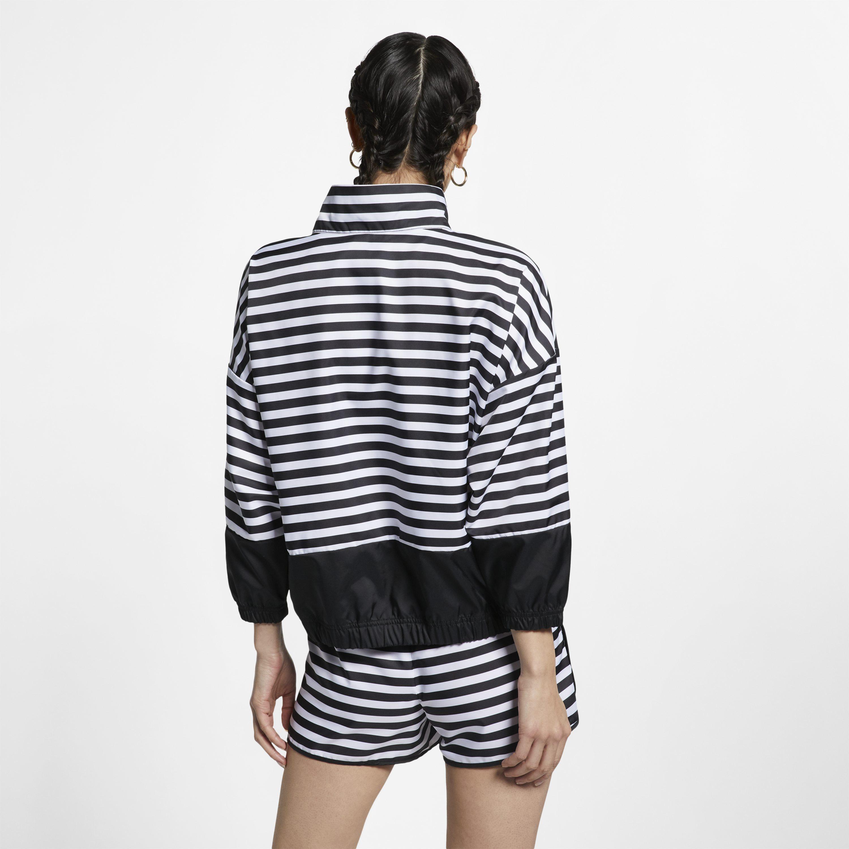 6d6c907d844f Nike Sportswear Animal Print Woven Jacket in White - Lyst