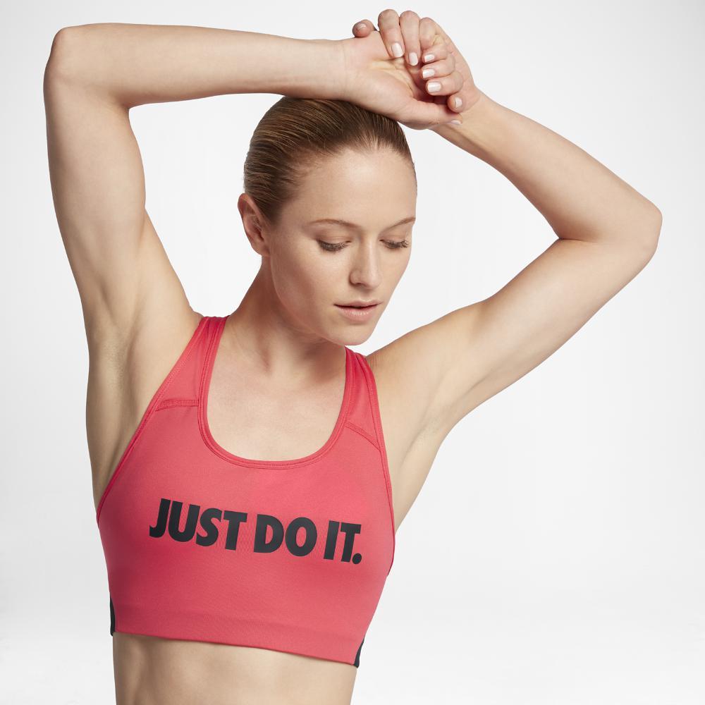 01677b4253 Lyst - Nike Classic Swoosh Cooling Women s Medium Support Sports Bra ...