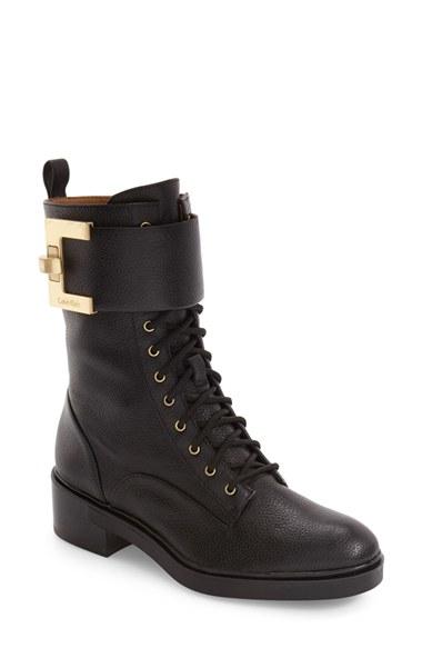 Calvin klein skyla buckle strap boots in black lyst for Calvin klein jardin collection
