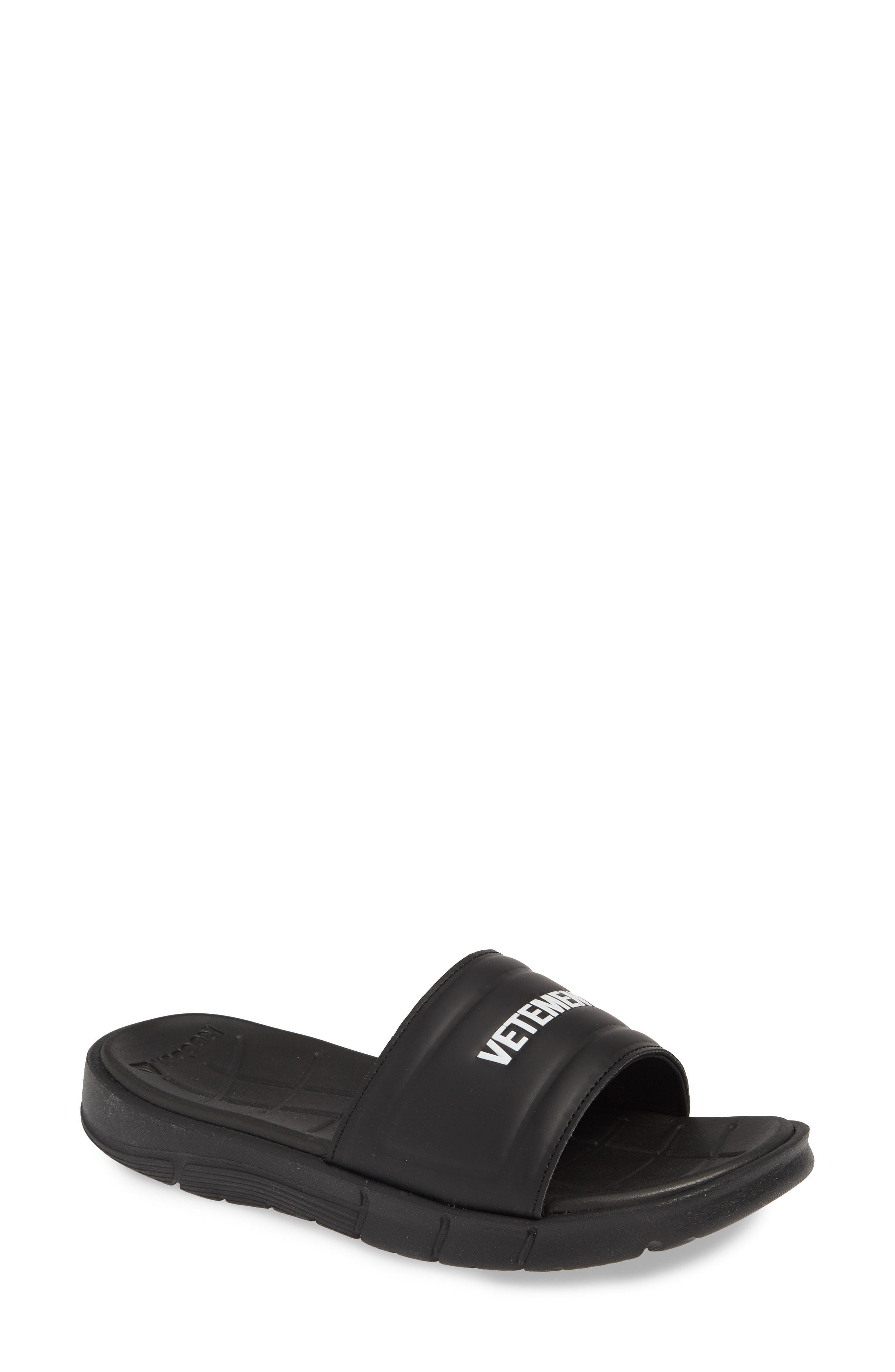 3a60e78385a9 Lyst - Vetements X Reebok Logo Slide Sandal in Black