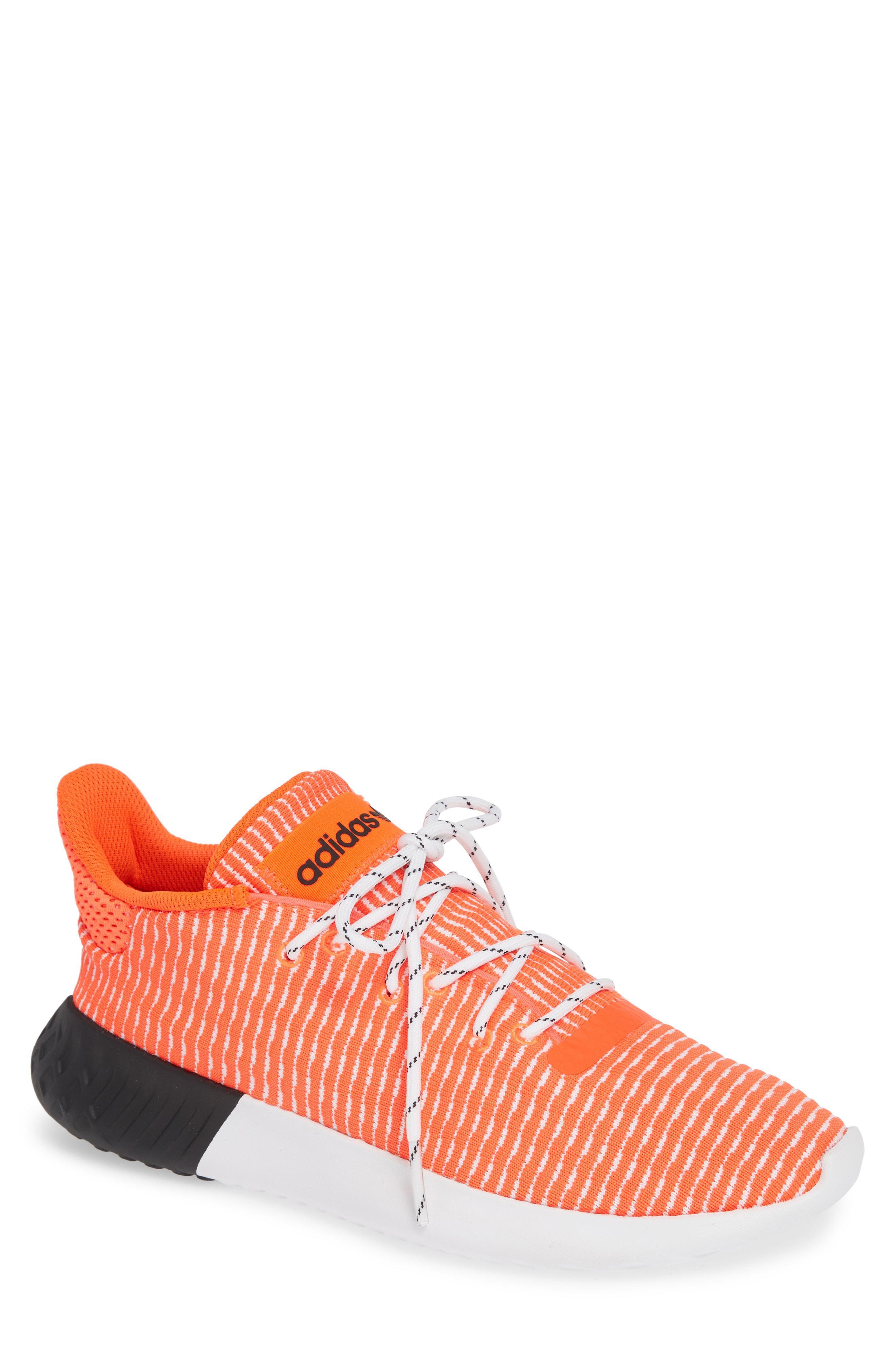 ae55ba19ea78 Adidas - Red Tubular Dusk Primeknit Sneaker for Men - Lyst. View fullscreen