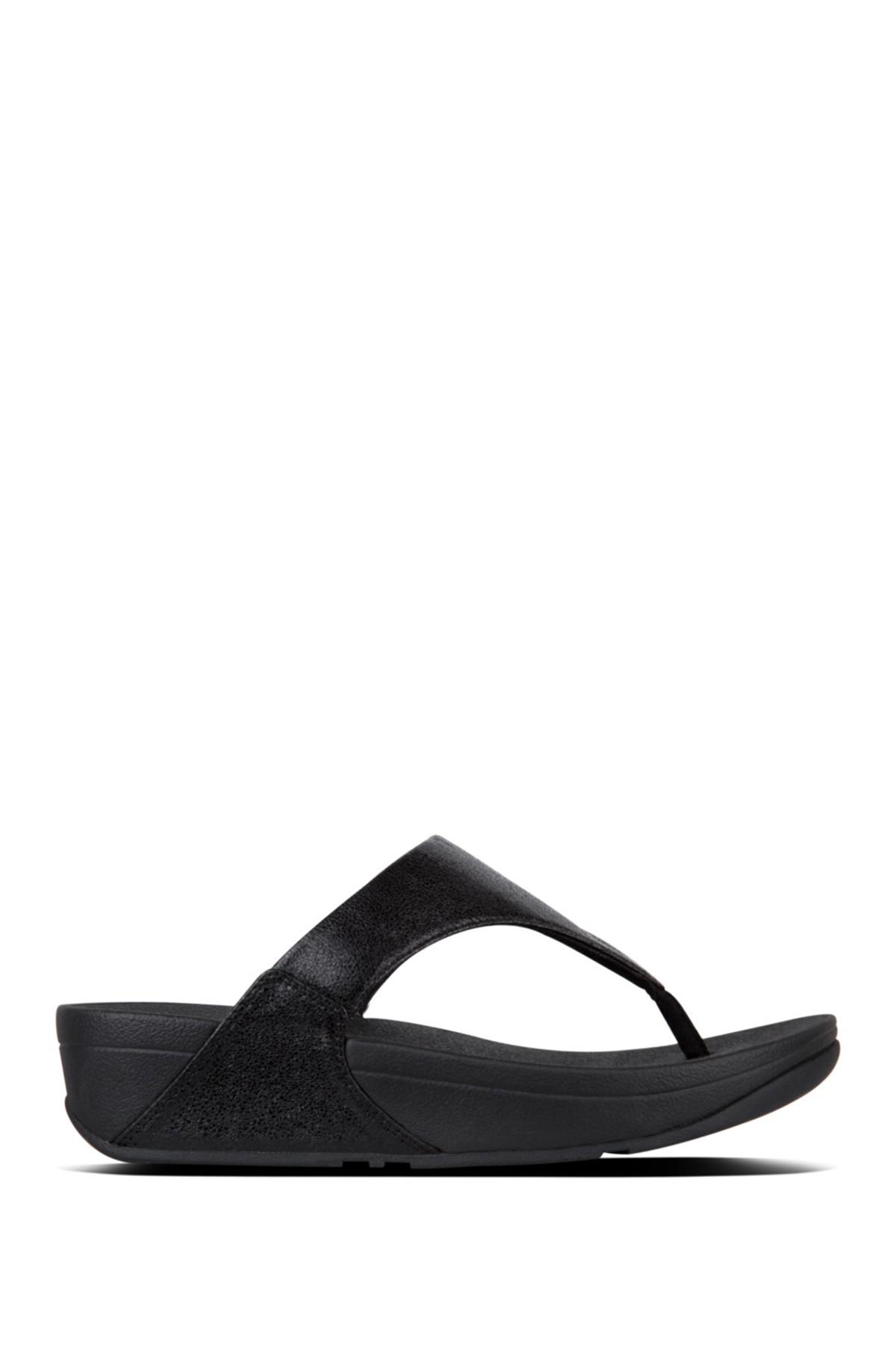 7268dc27a0a7 Lyst - Fitflop Lulu Faux Leather Thong Wedge Sandal in Black - Save 22%