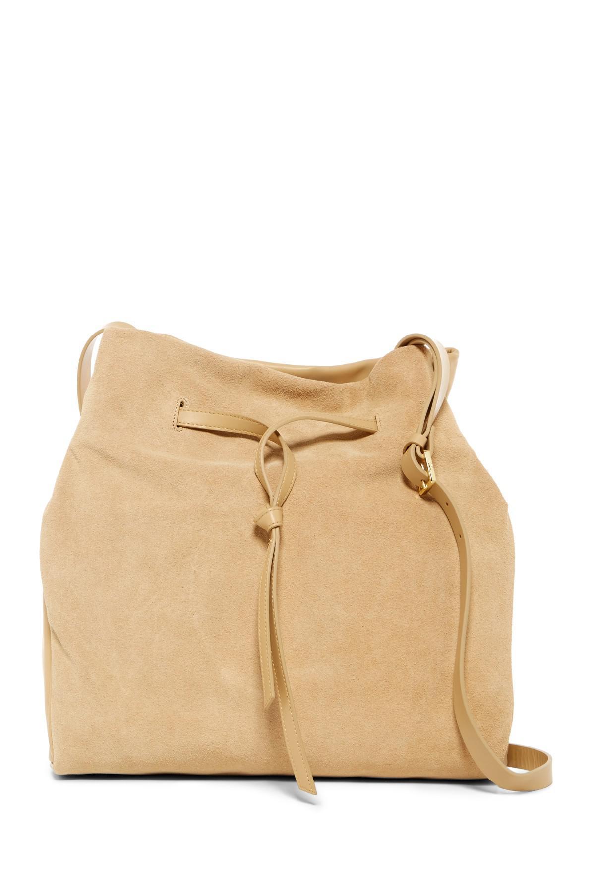 0212498cb526 Lyst - Halston Olivia Suede   Leather Drawstring Shoulder Bag in Natural