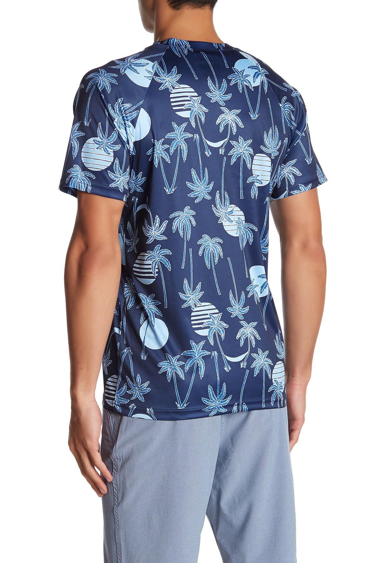 6e20e98eda9dd TRUNKS SURF AND SWIM CO - Blue Tropical Palm Print Upf 50+ Swim T-. View  fullscreen