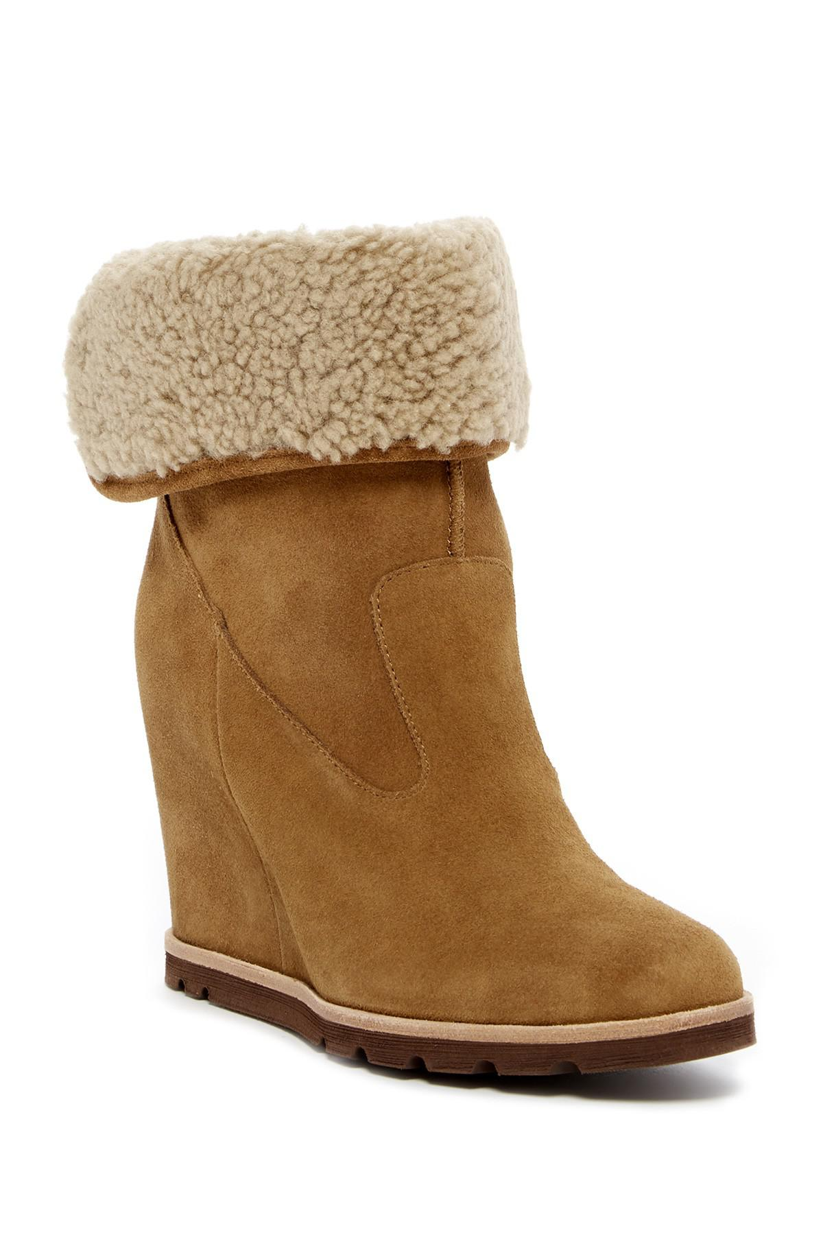 2aa32aab29a Lyst - UGG Kyra Genuine Shearling Wedge Boot in Brown