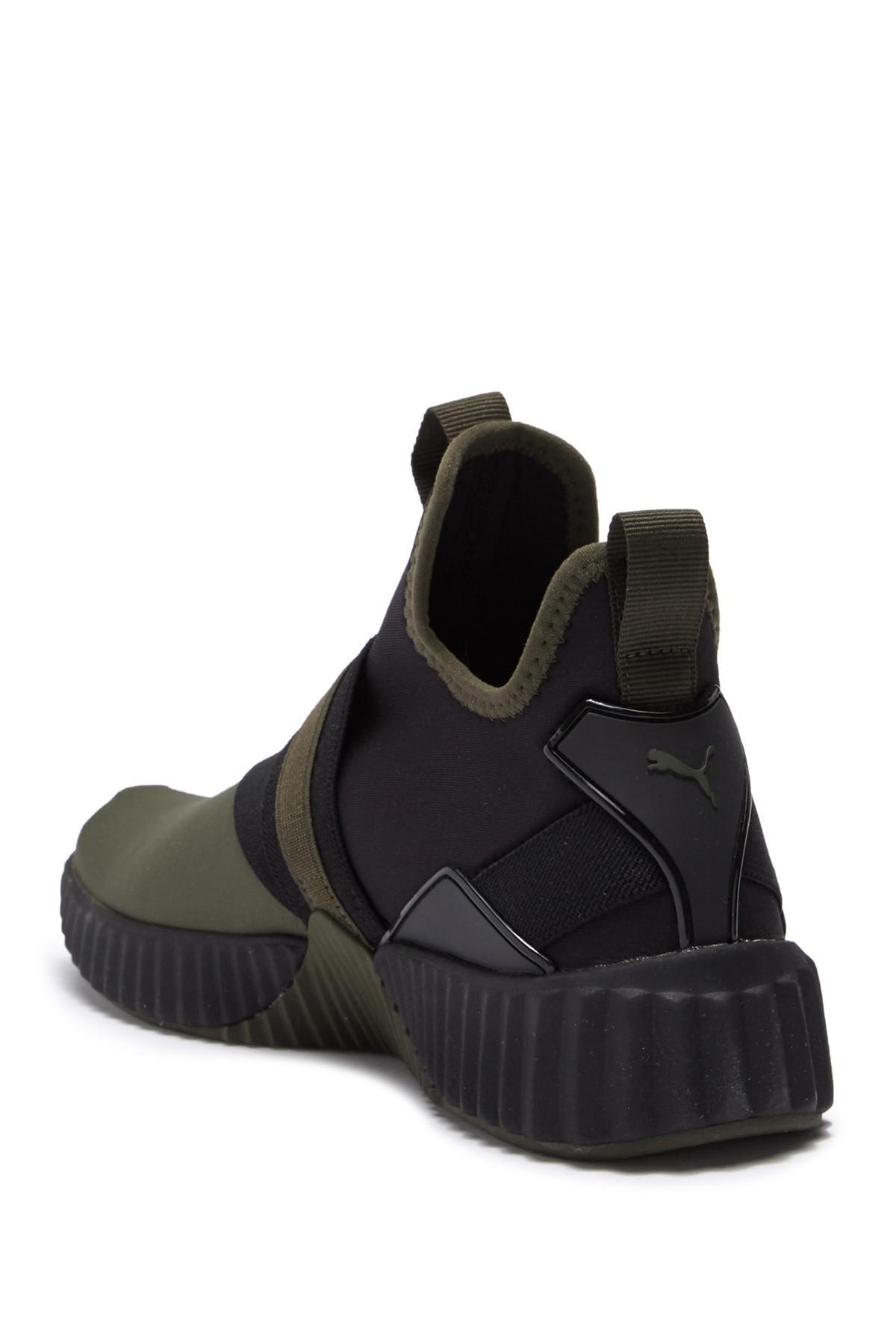 PUMA Defy Mid Street Wns Sneaker in