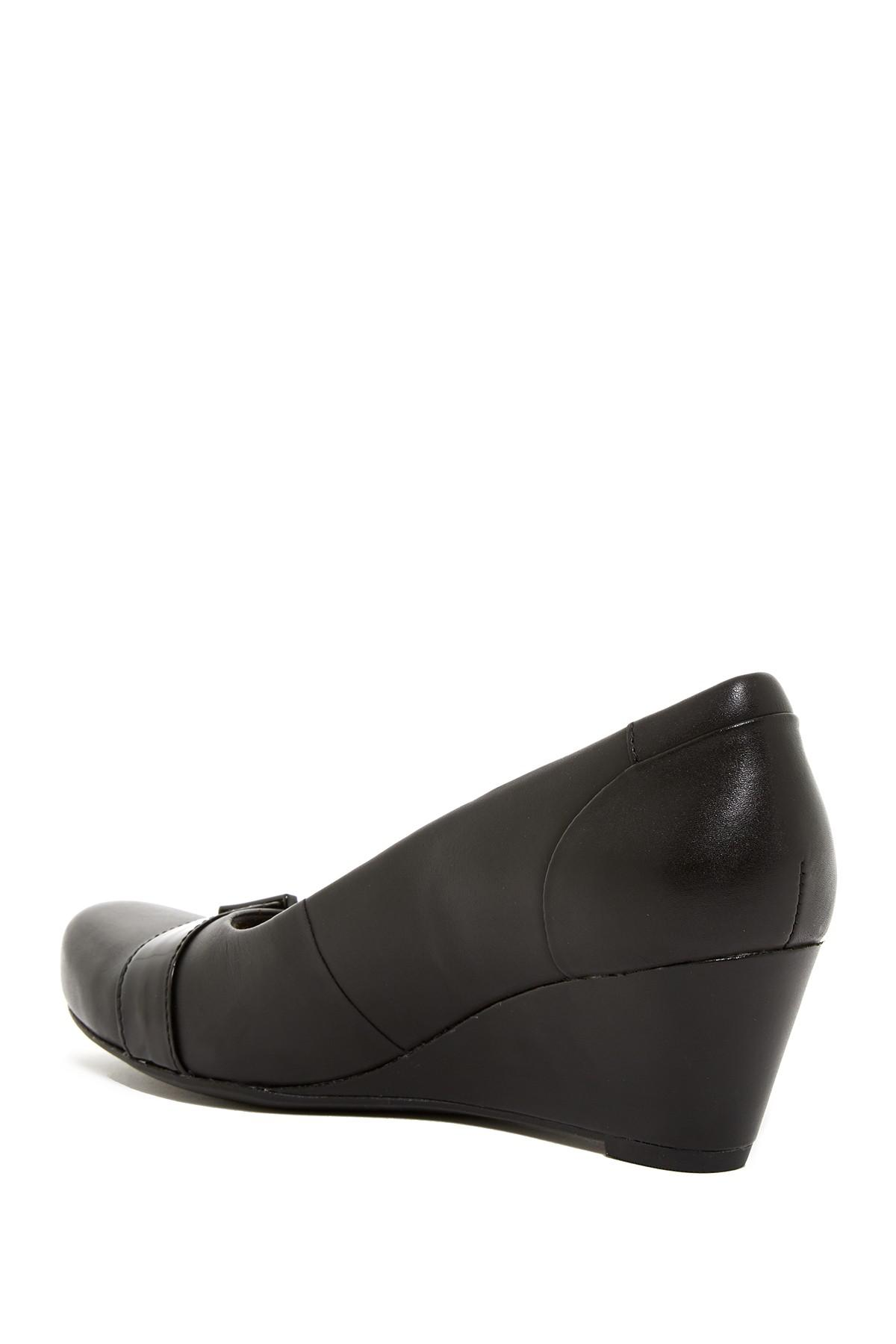 0c4349098711 Lyst - Clarks Flores Poppy Wedge Pump - Wide Width Available in Black
