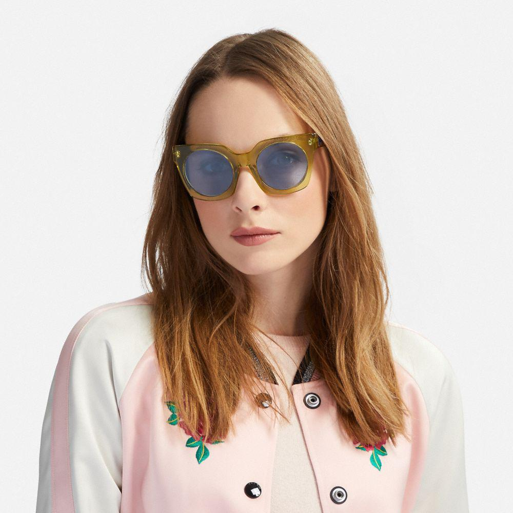 c2946a752371 COACH Horse And Carriage Hologram Sunglasses in Blue - Lyst