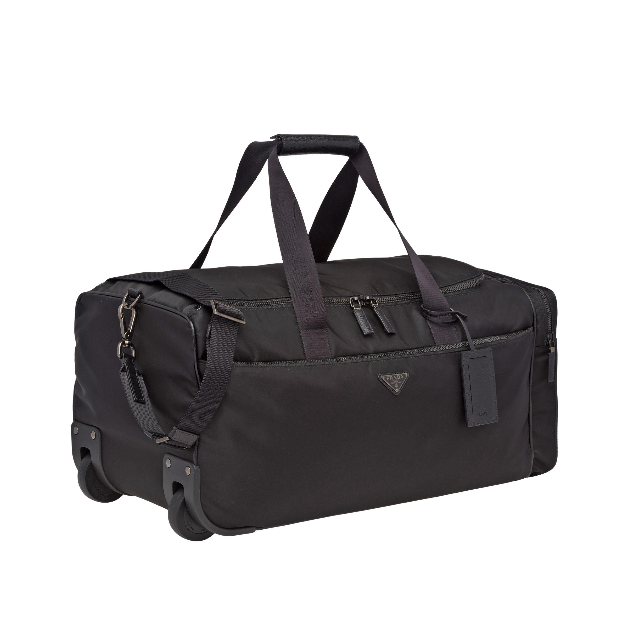 16e0f5a155e0 Lyst - Prada Nylon And Saffiano Leather Wheeled Carry-on in Black ...