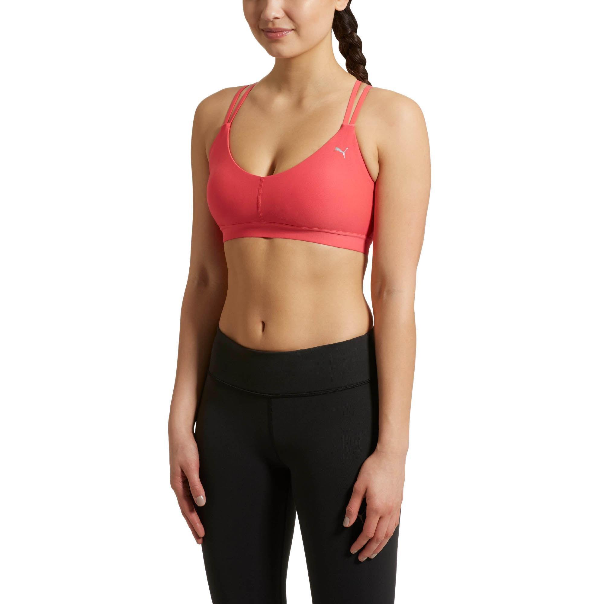 0e5017fd36193 Lyst - Puma Yogini Lux Strappy Bra Top in Pink