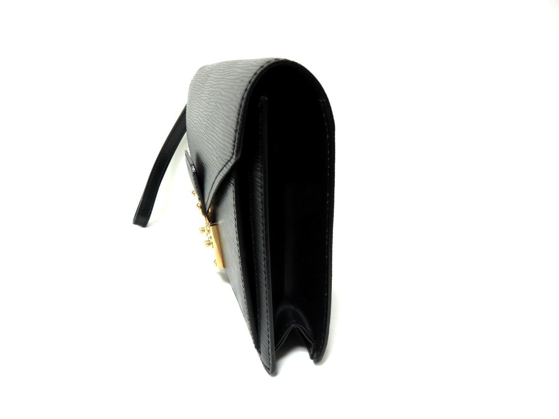 2dfb64c4ef2d Lyst - Louis Vuitton Pochette Serie Dragonne Second Crutch Bag ...