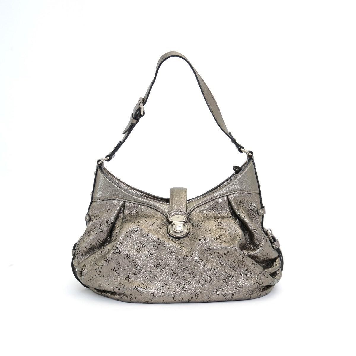 3c911e541f83 Lyst - Louis Vuitton Calf Mahina Xs Bronze Handbag M95717 in Metallic
