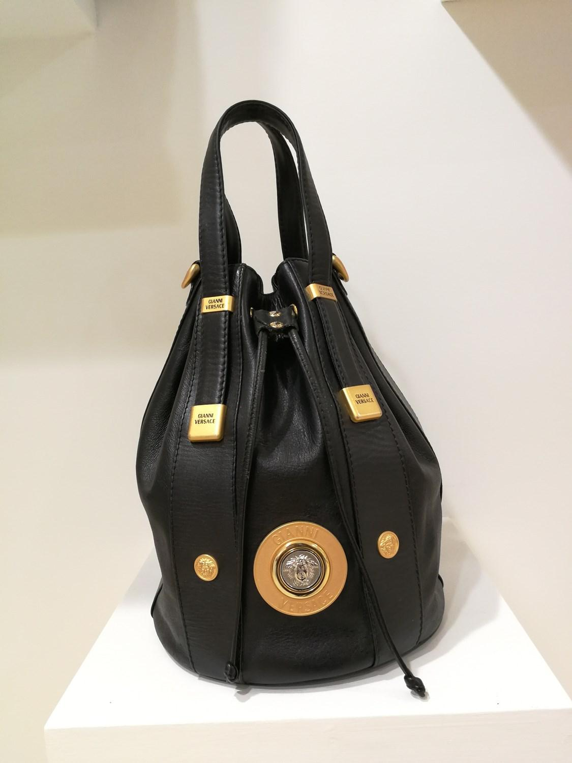 3a679967c5f ... Versace Small Dv One Bag Black Reebonz  on sale e1dfd 87a2d Black  Backpack With Gold Spikes ...
