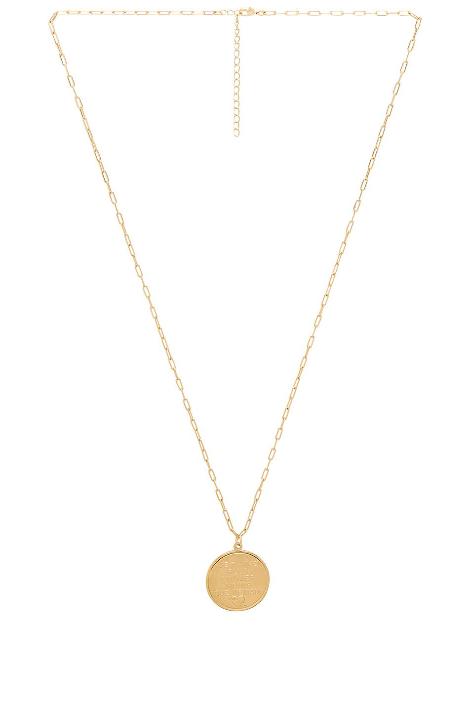 Joolz by Martha Calvo French Quote Disc Necklace In Metallic Gold.