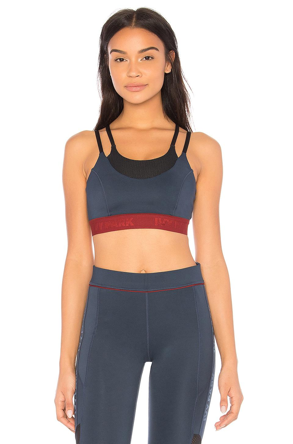 a75aac1150 Lyst - Ivy Park Color Block Sports Bra in Blue