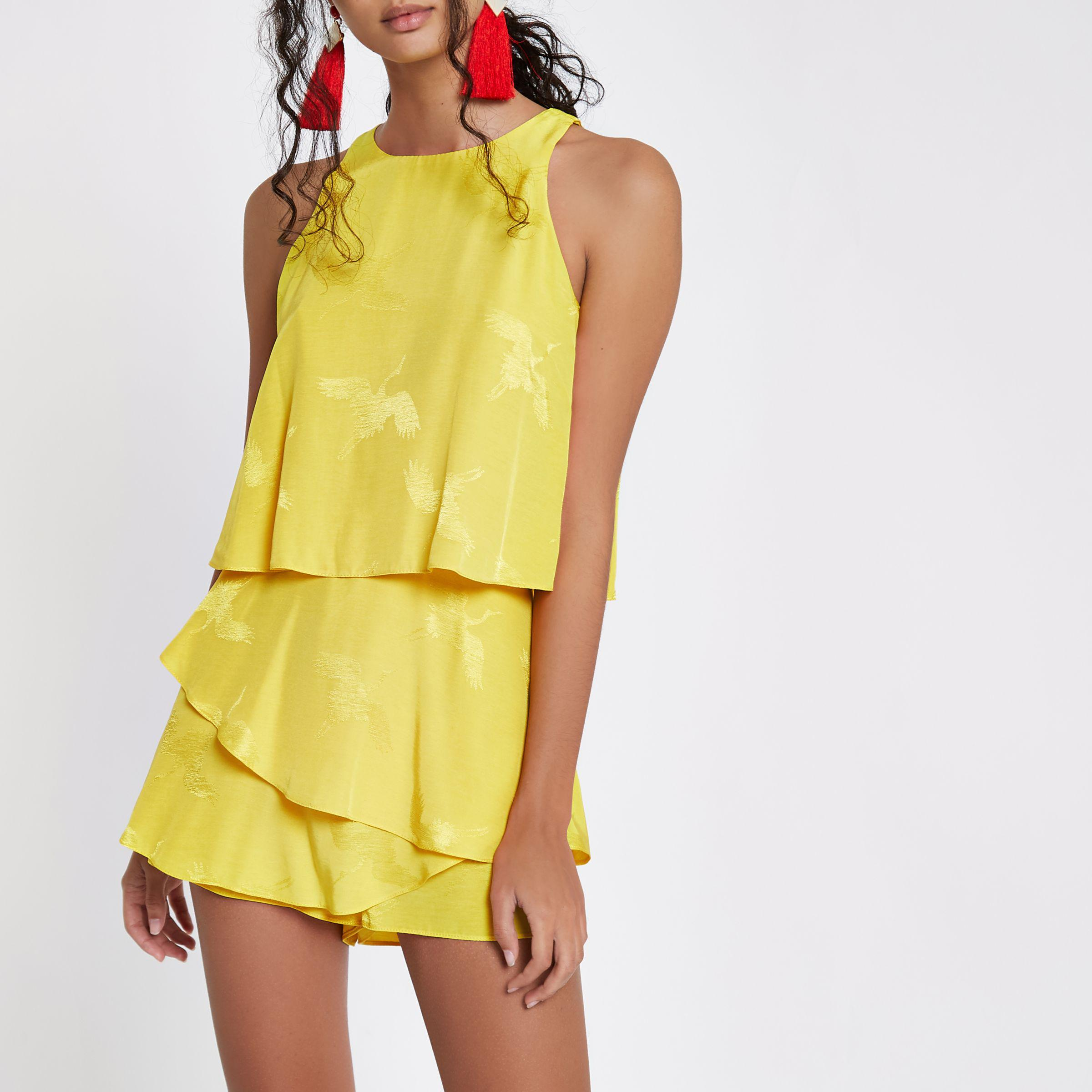 b2c02b65a12 Lyst - River Island Tiered Frill Jacquard Playsuit in Yellow