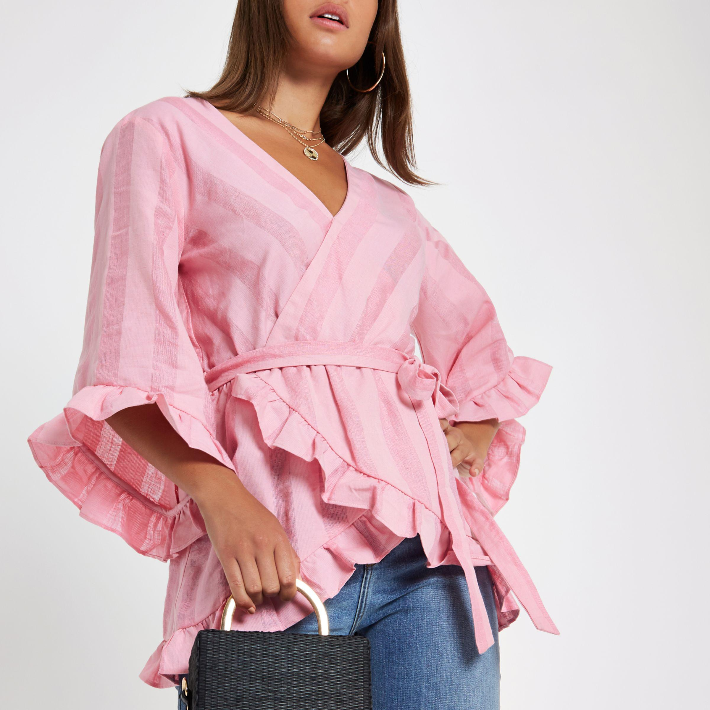 851a289904217 Lyst - River Island Pink Stripe Wrap Tie Waist Frill Blouse in Pink