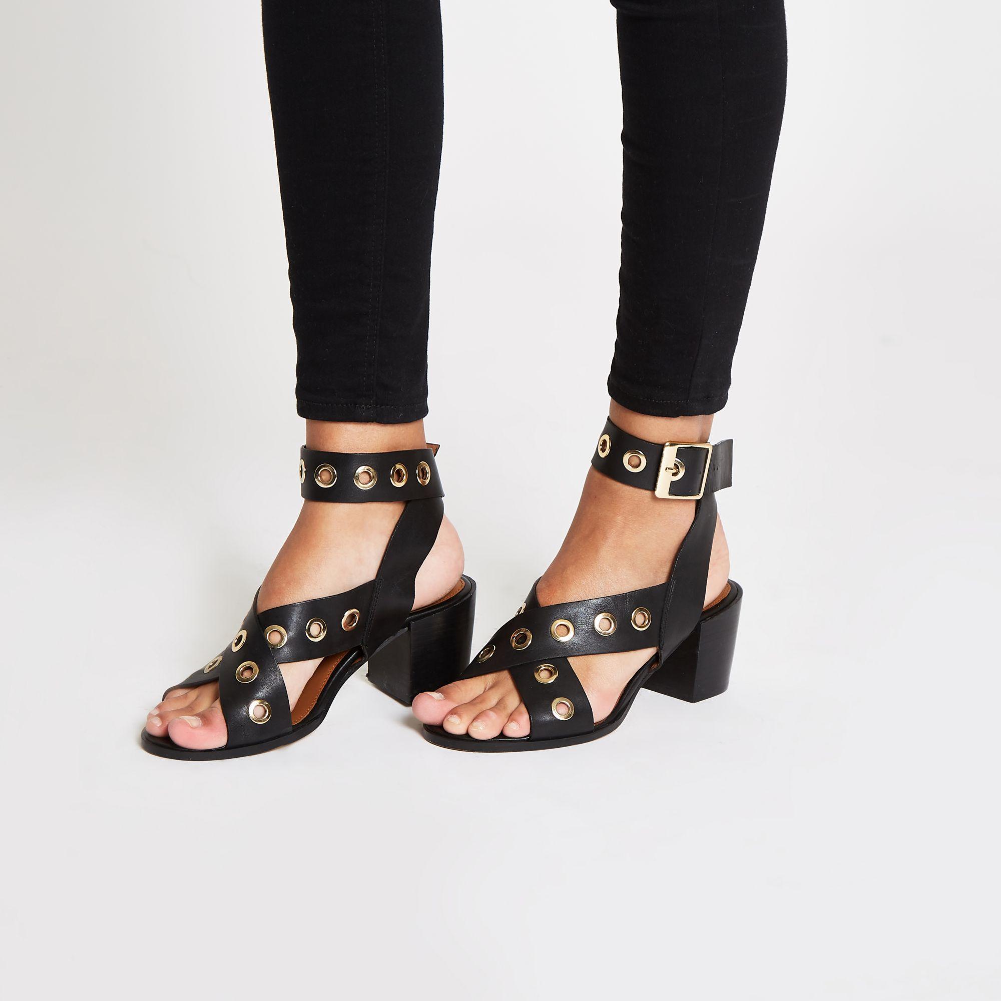 bc58d9158ca5 ... Black Leather Eyelet Block Heel Sandals - Lyst. View fullscreen