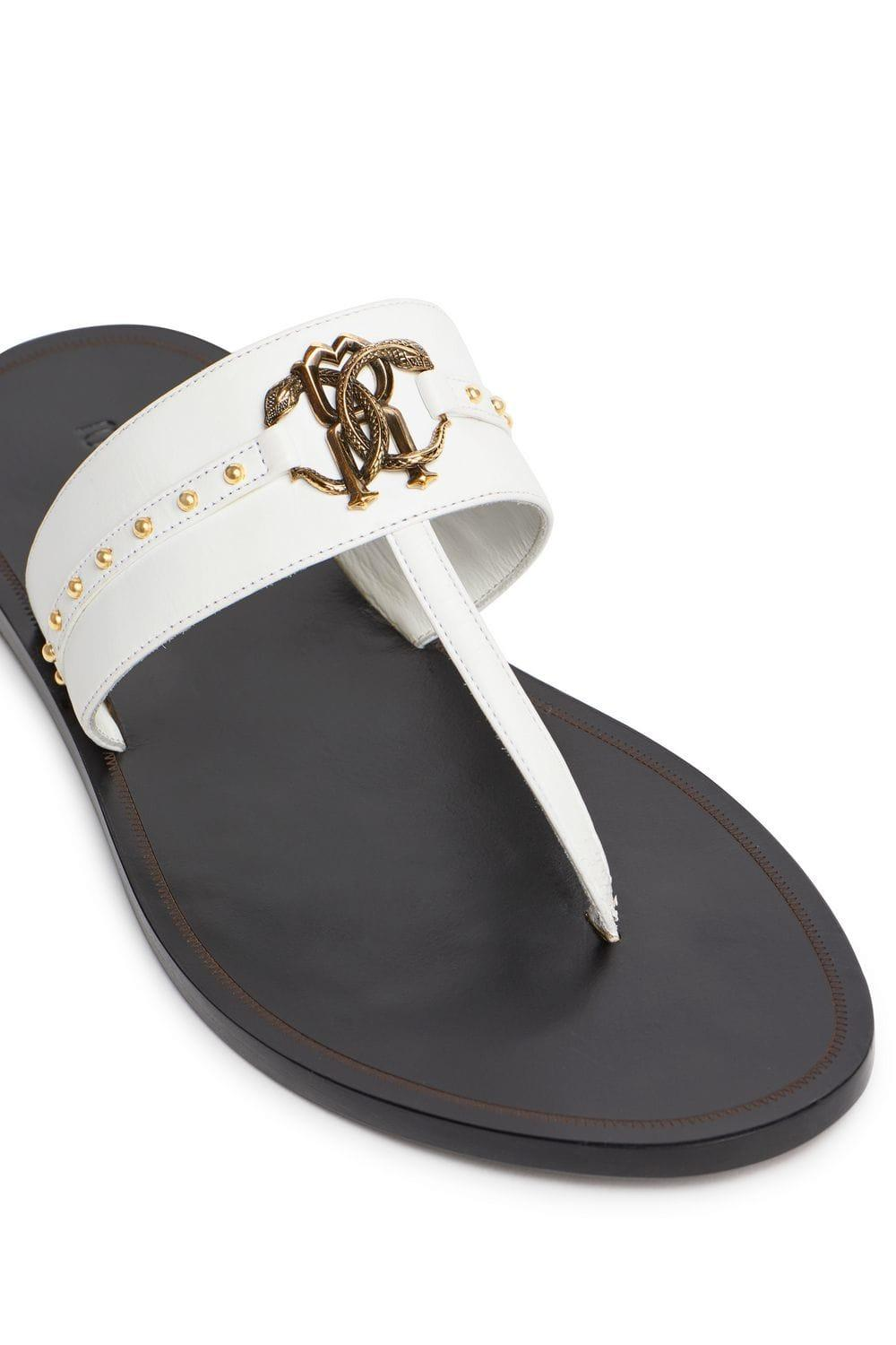 b30e32c67 Lyst - Roberto Cavalli Stud Embellished Leather Flat Sandals in White