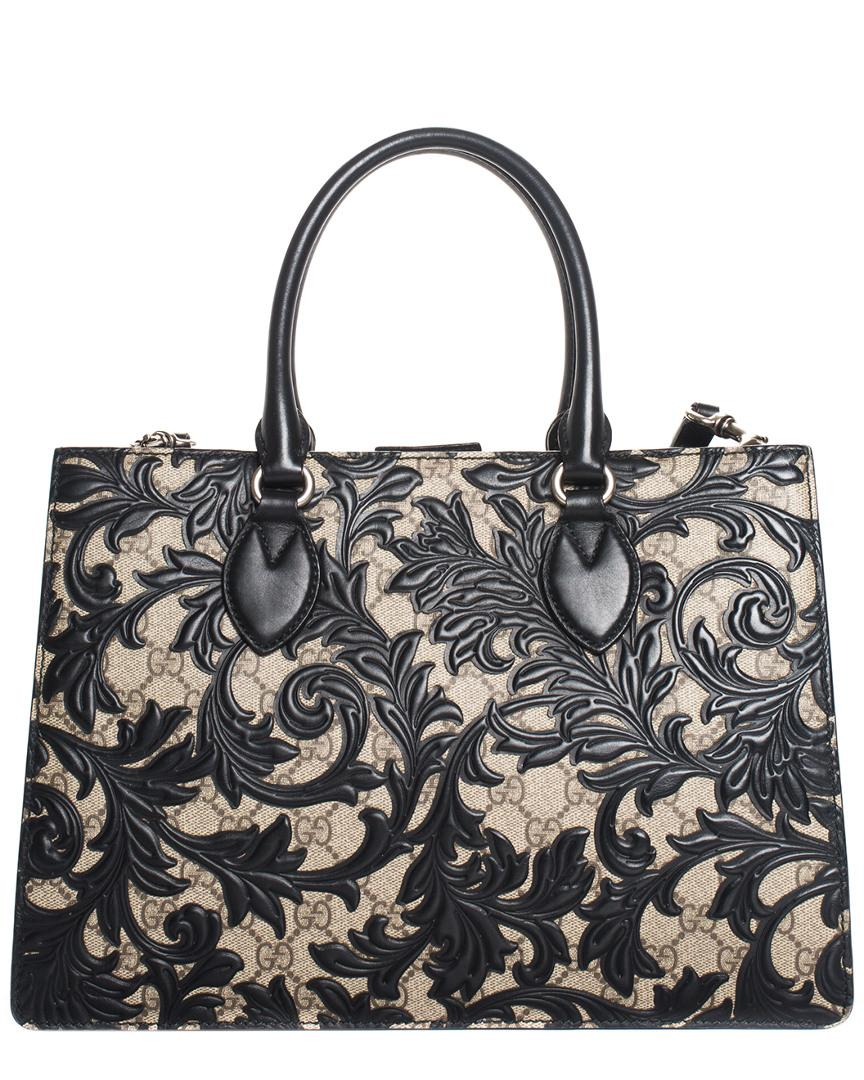 1ac3102ec85c Lyst - Gucci Brown GG Supreme Canvas   Black Leather Arabesque Tote in Black