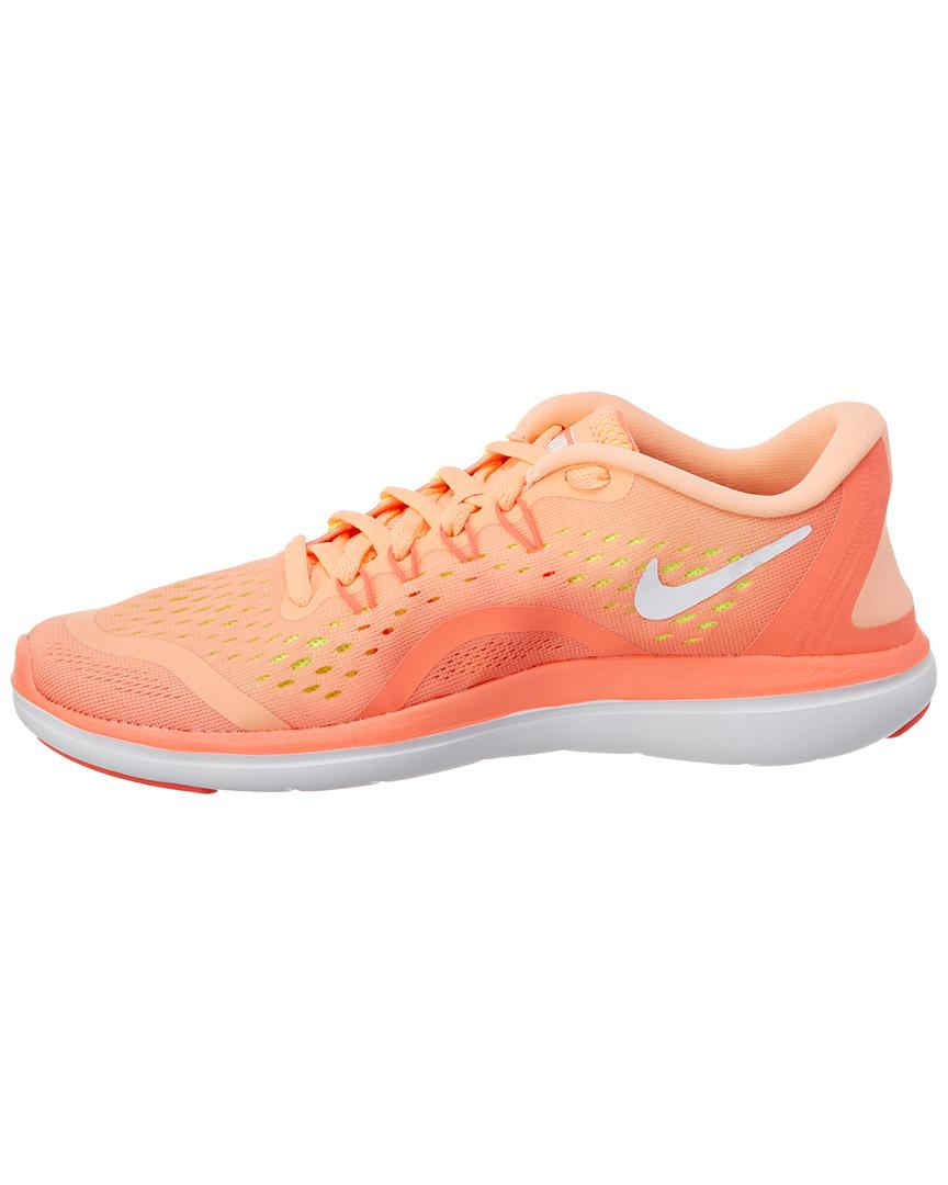 bd211ebfcd5fd Lyst - Nike Women s Flex 2017 Rn Running Shoe in Orange