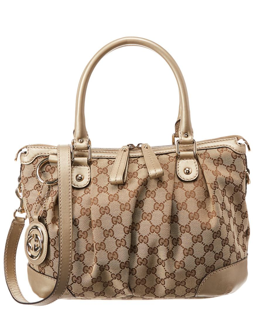 d04f4e826ea2cd Gucci. Women's Gold GG Canvas & Leather Sukey Bag