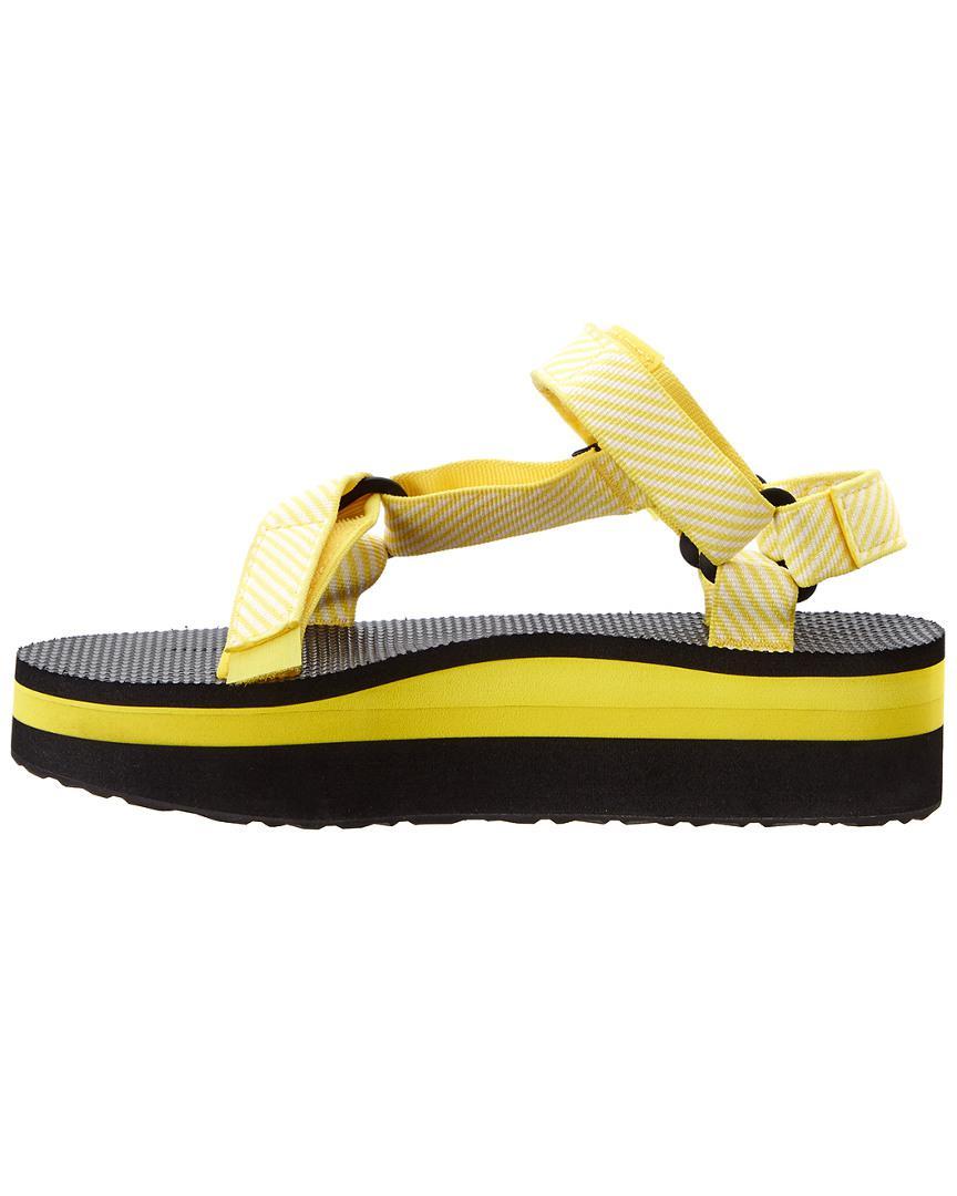 d16a7ae190d teva flatform yellow Lyst - Teva Women s Flatform Universal Sandal in Yellow