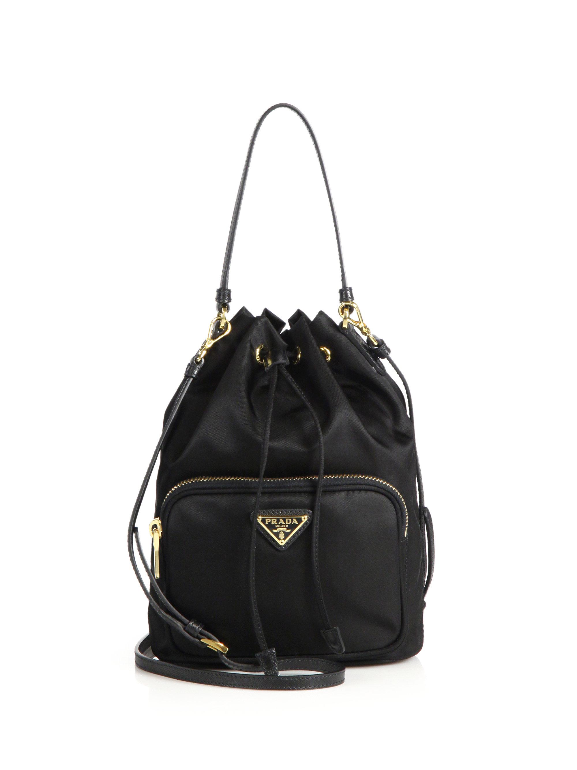 860a49fac5f7 ... coupon lyst prada mini nylon leather bucket bag in black b013c bc7f2 ...