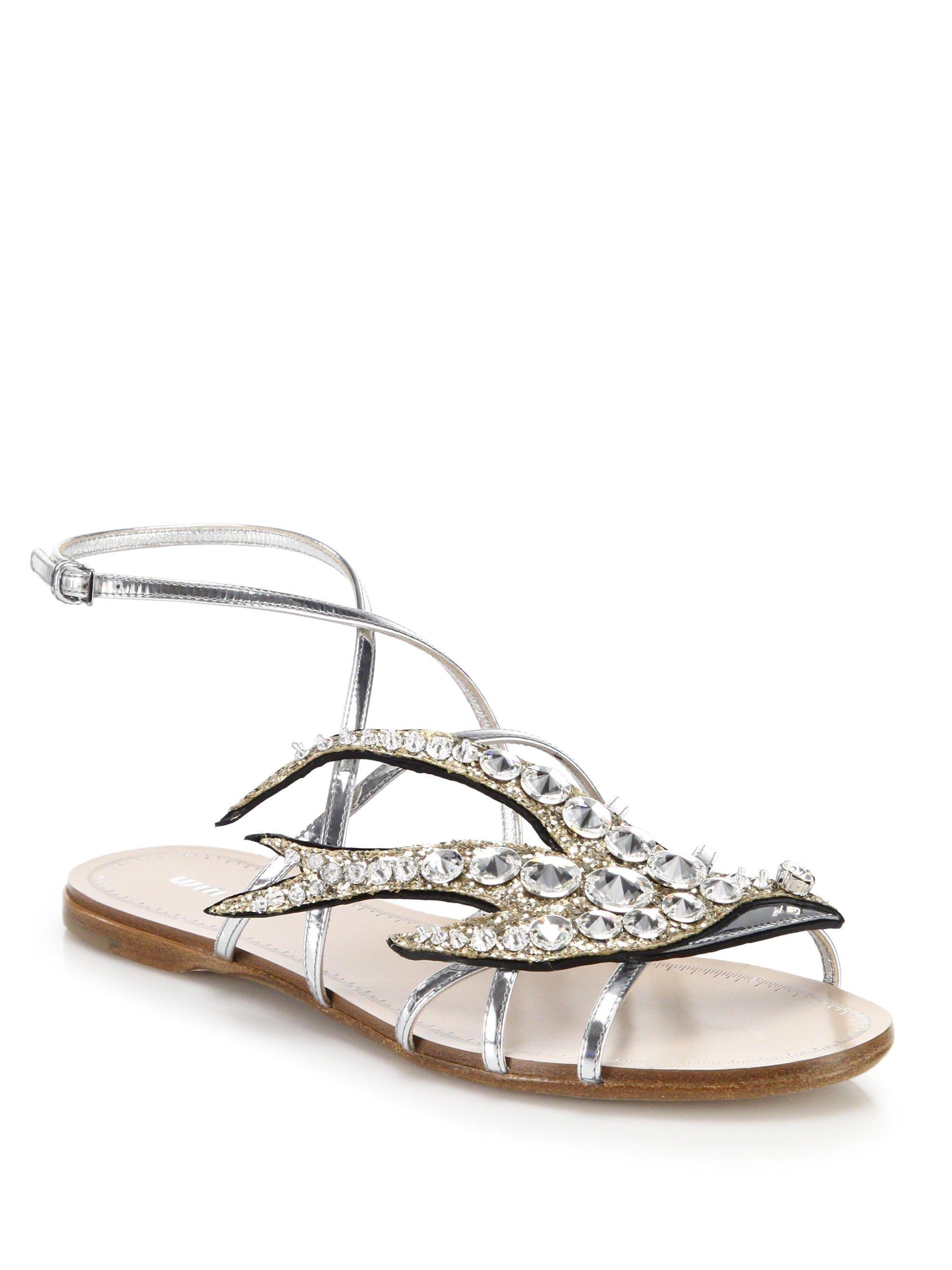 c7bd43d49 Lyst - Miu Miu Swallows Crystal Flat Sandals in Metallic