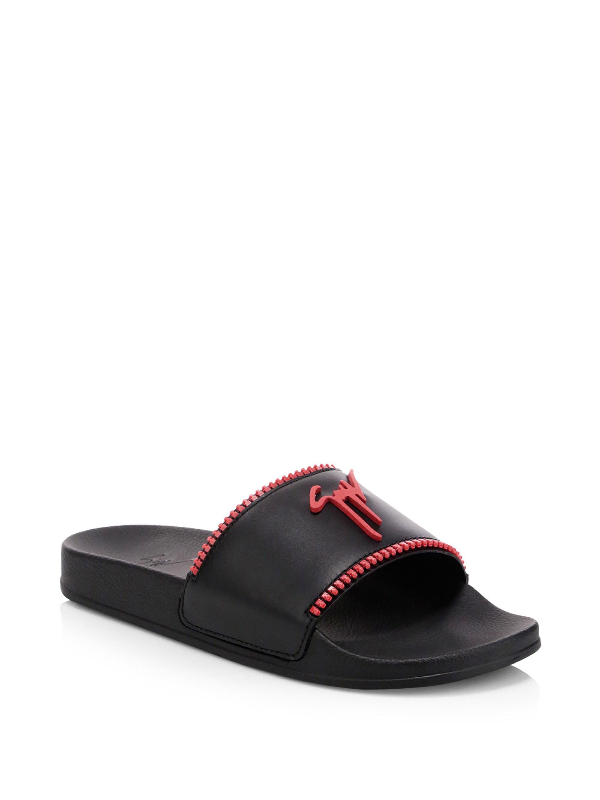 cheap for discount ee169 08f99 giuseppe-zanotti-black-Logo-Rubber-Zipper-Slides.jpeg