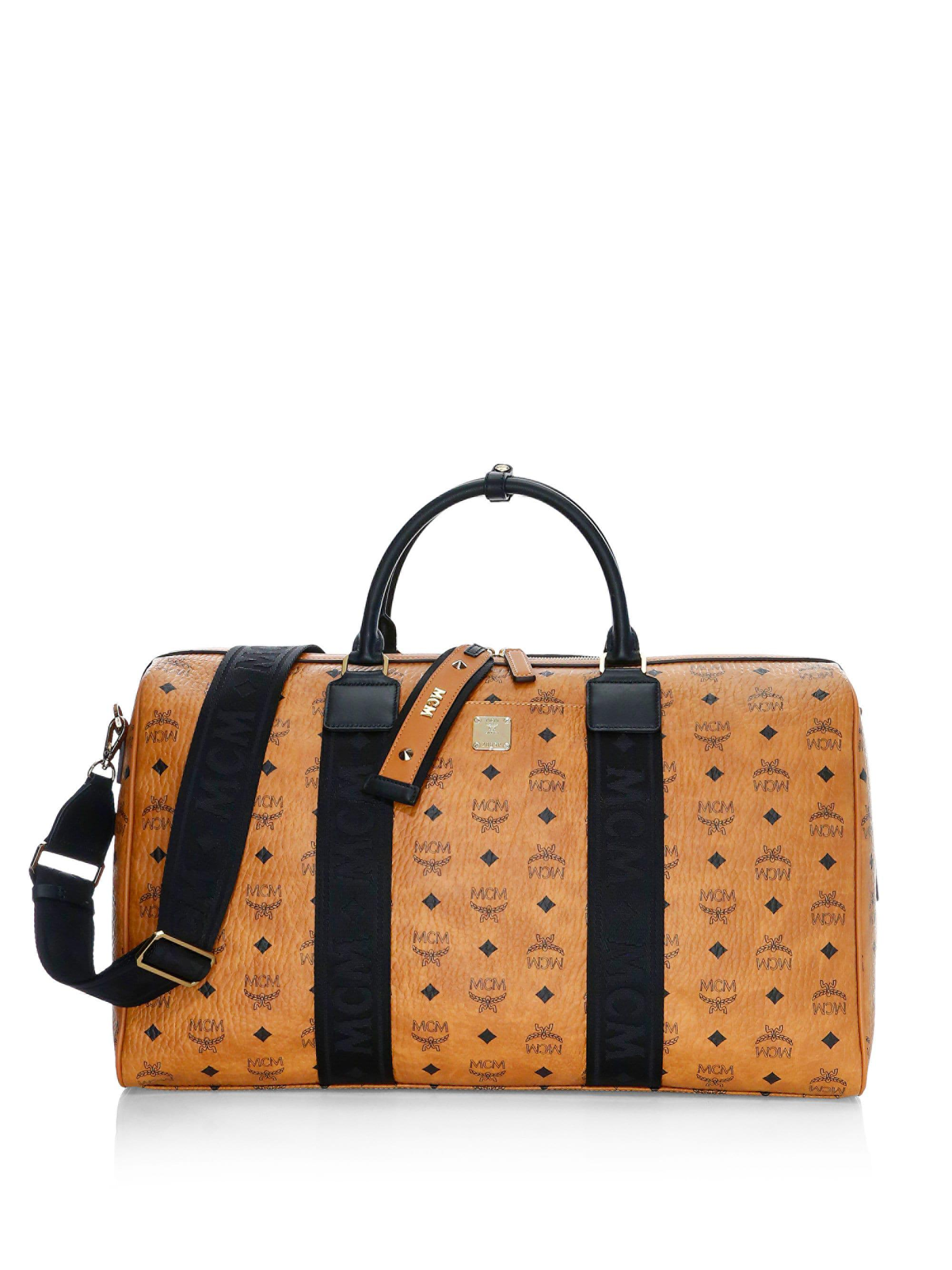 21084e63b6 ... Weekender Visetos Coated Canvas Traveler Duffel Bag for Men - Lyst.  View fullscreen