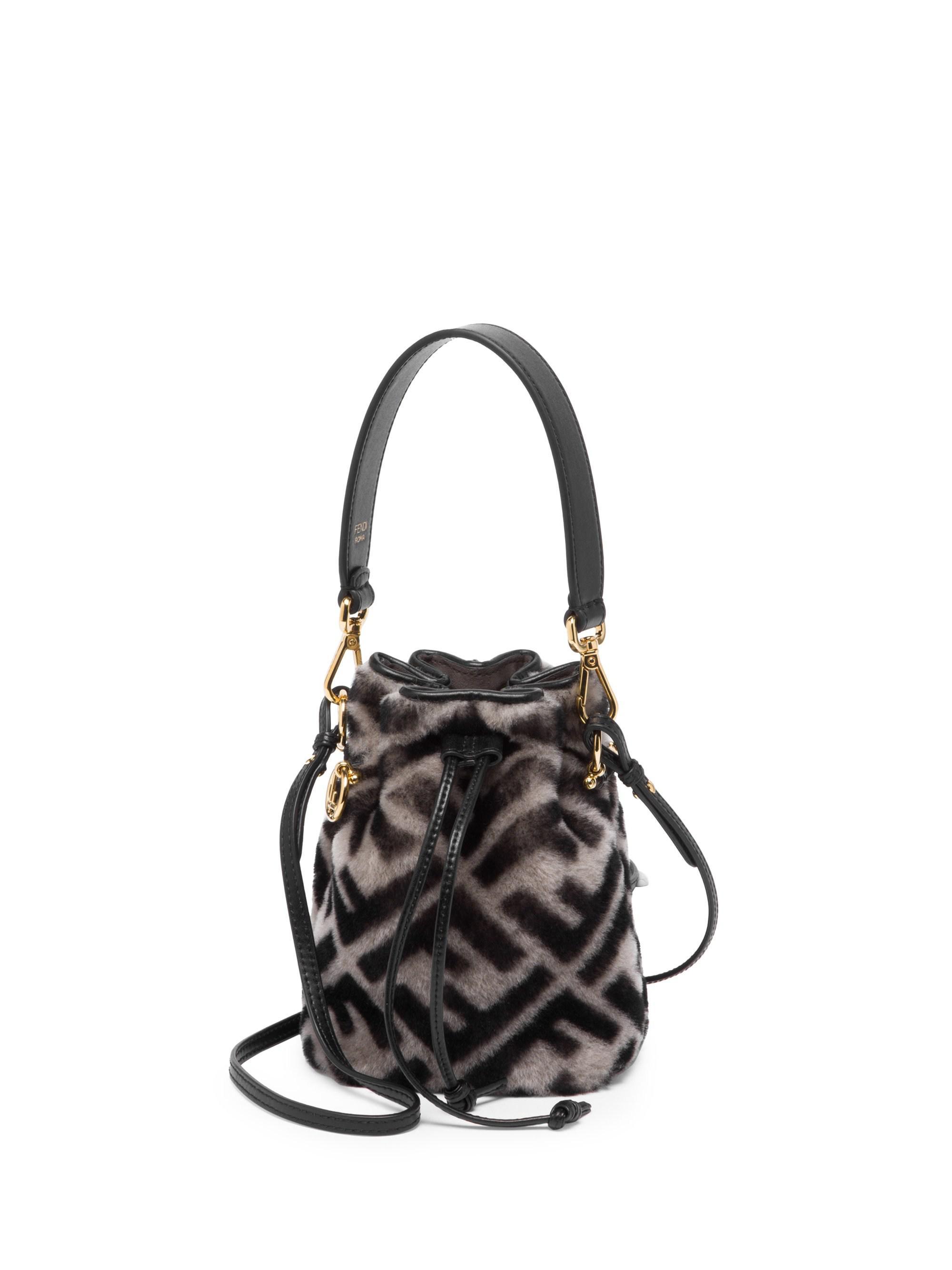 84e8ed0330e Fendi Mini Mon Tresor Shearling Bucket Bag in Black - Lyst