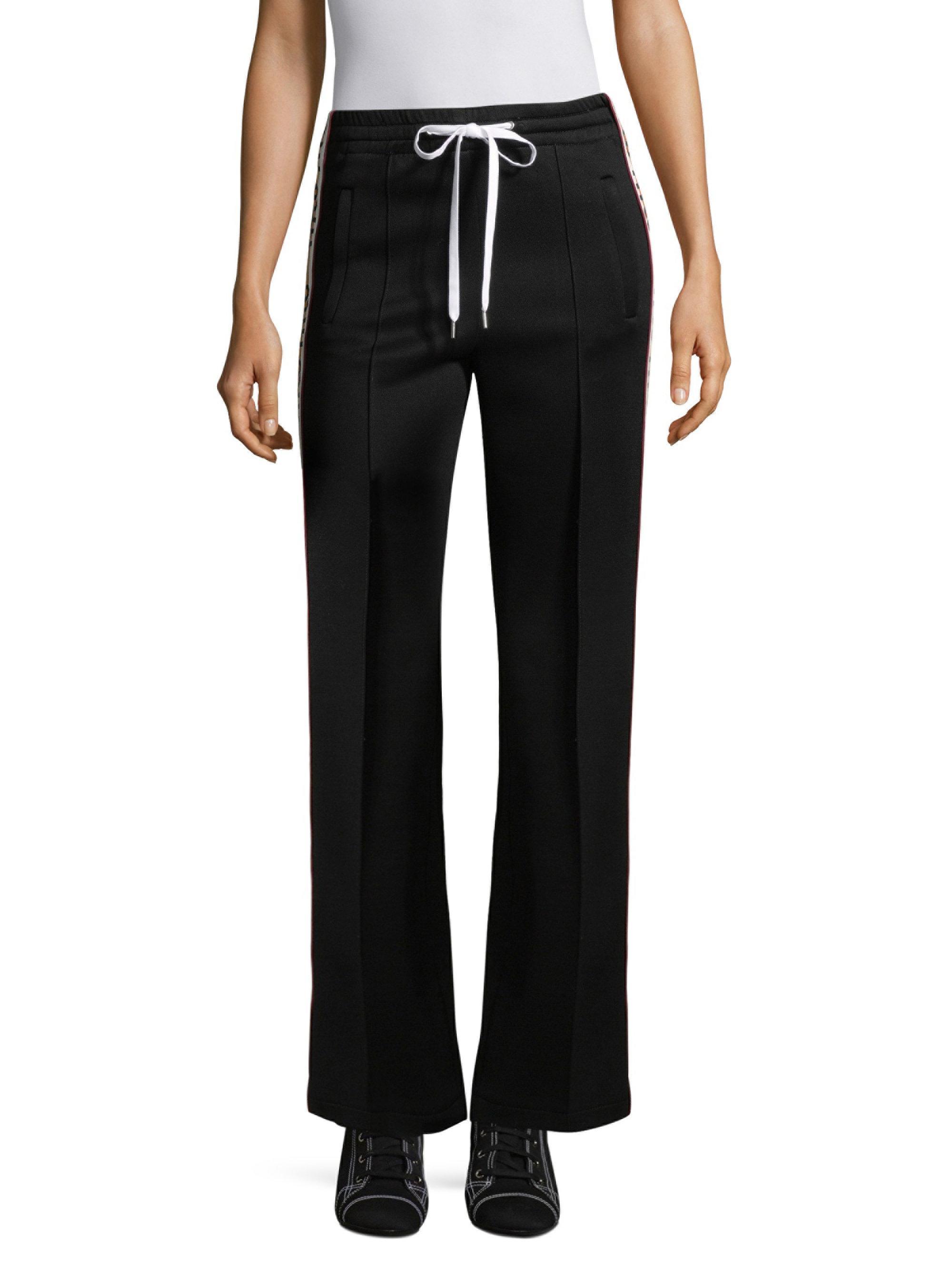 08d1bdaba1db Miu Miu Logo Jersey Tracksuit Pants in Black - Lyst