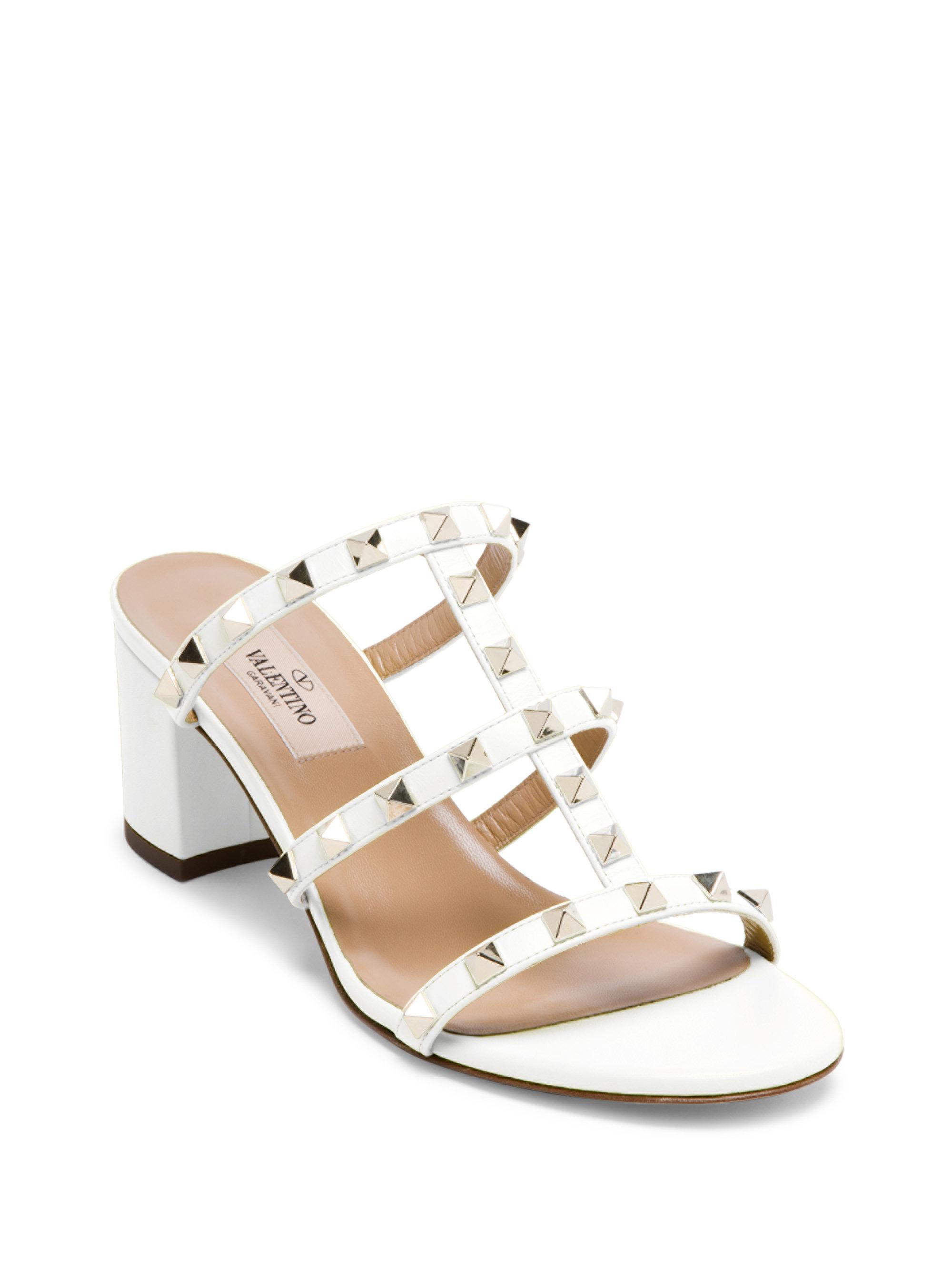 2ded1866f5 Valentino Rockstud Leather Block Heel Slides in White - Lyst