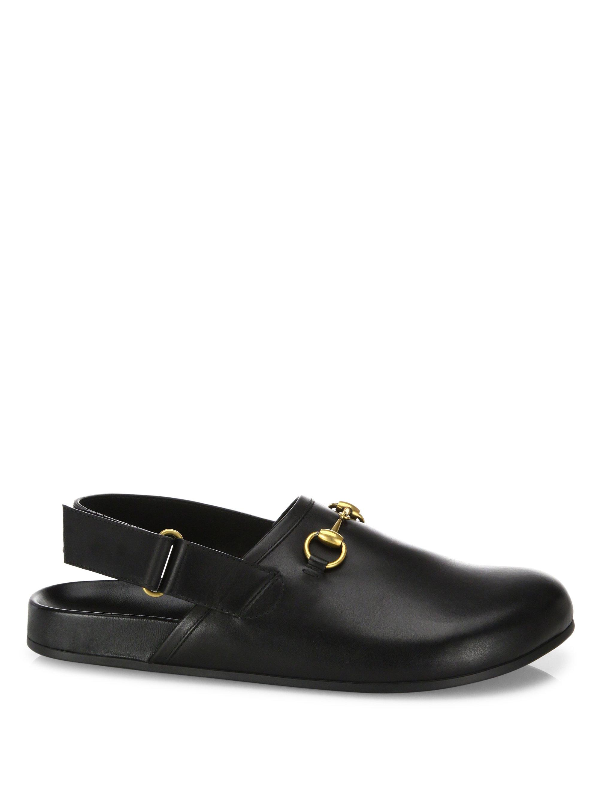 Gucci. Women's Black River Leather Clogs