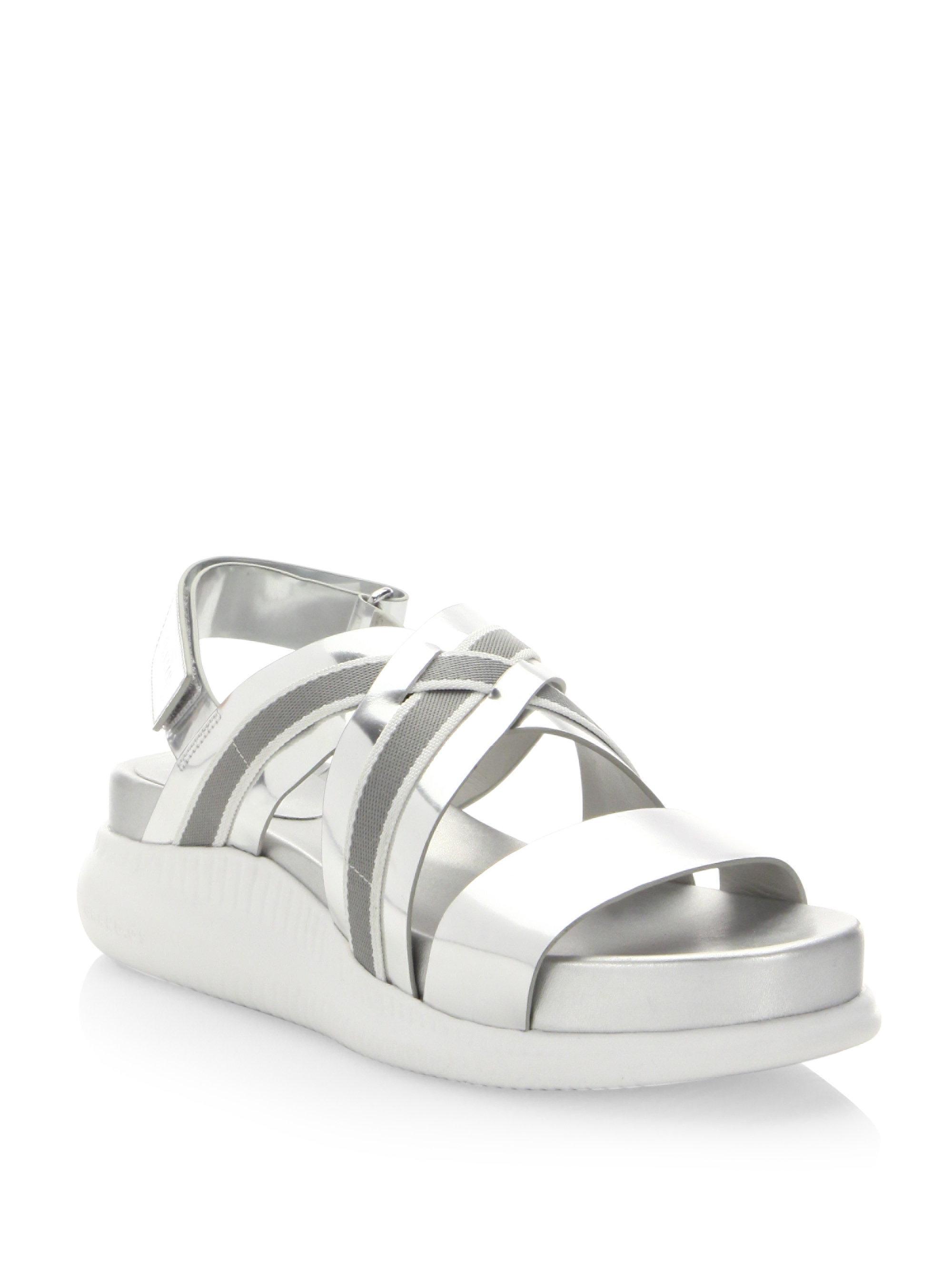 de2fe56fb Lyst - Cole Haan Zerogrand Chris Cross Wedge Sandals in Metallic